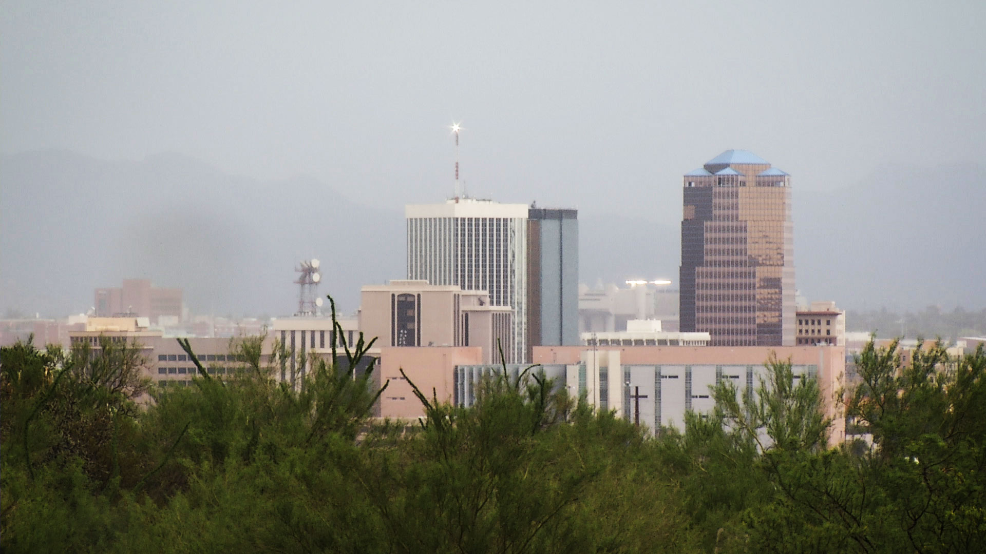 File image shows the downtown Tucson skyline on a rainy day.