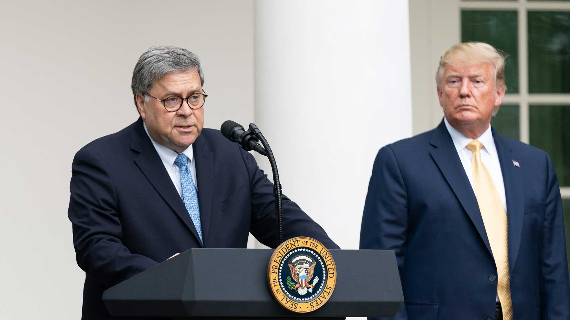 Attorney General Willam Barr speaks at the White House July 11, 2019, as President Donald Trump looks on.