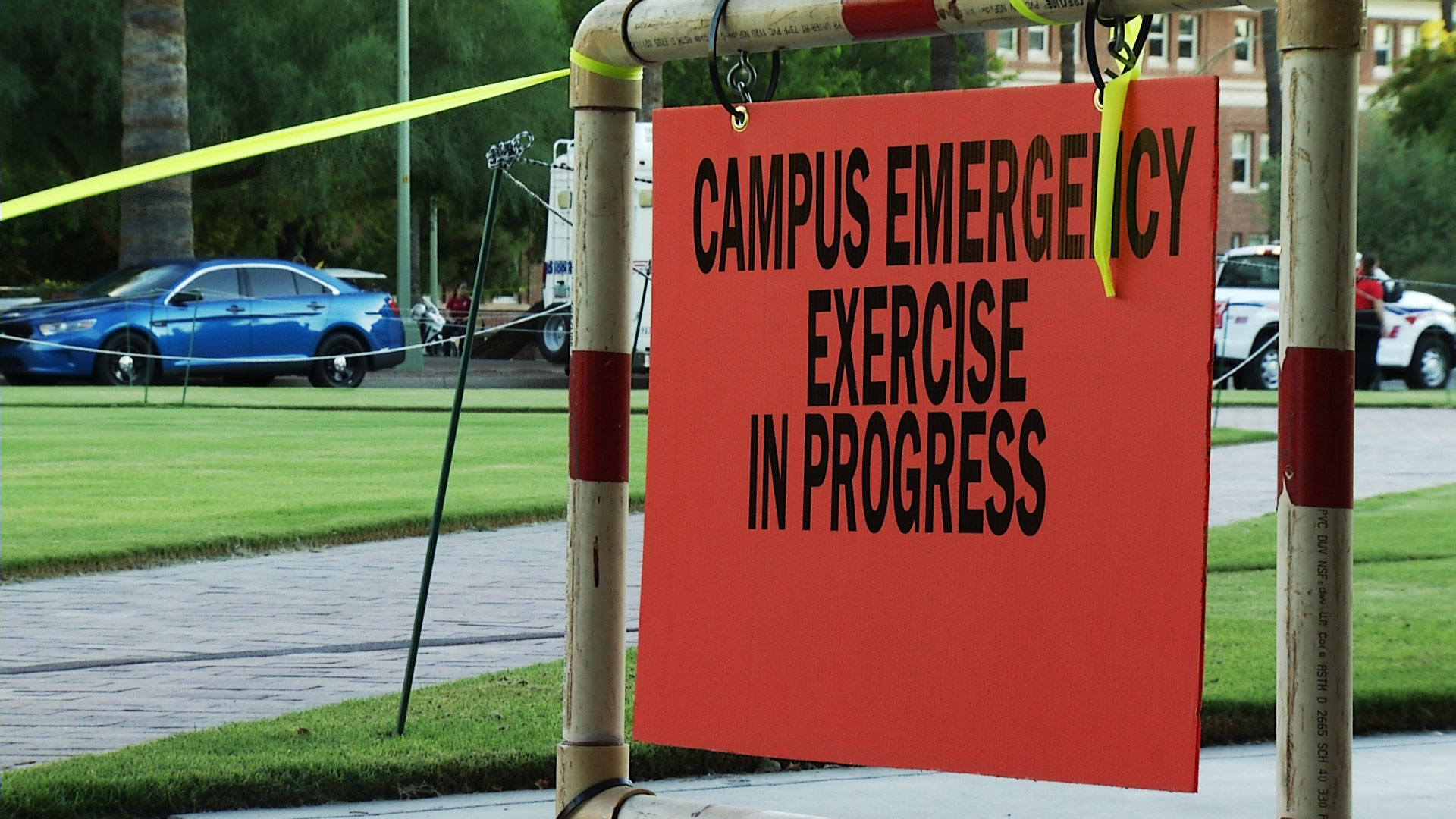 A sign notifies the public about an active shooter drill taking place at the University of Arizona on August 14, 2019.