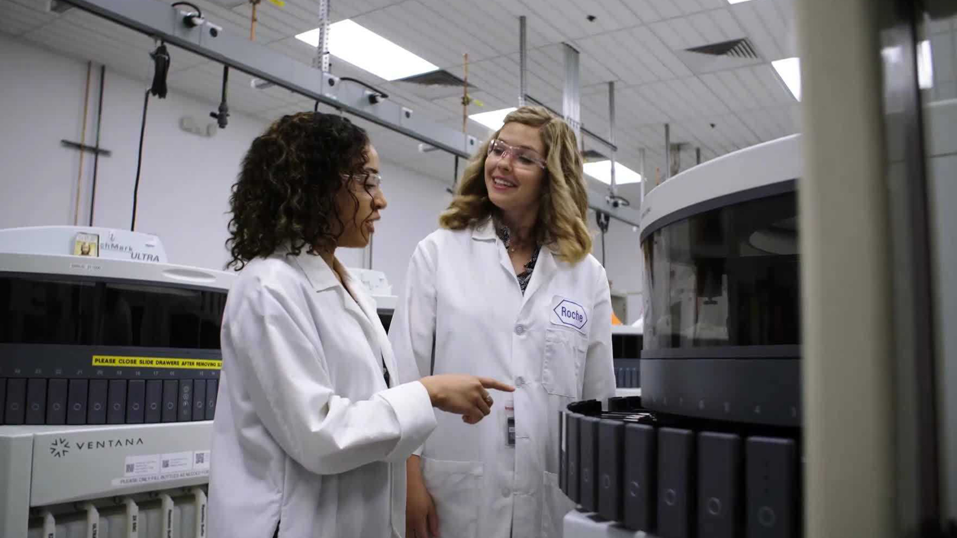 Roche senior manager Heidi Barnett, left, and Empire High School chemistry teacher Hillary Stacey at Roche/Ventana's Oro Valley lab.