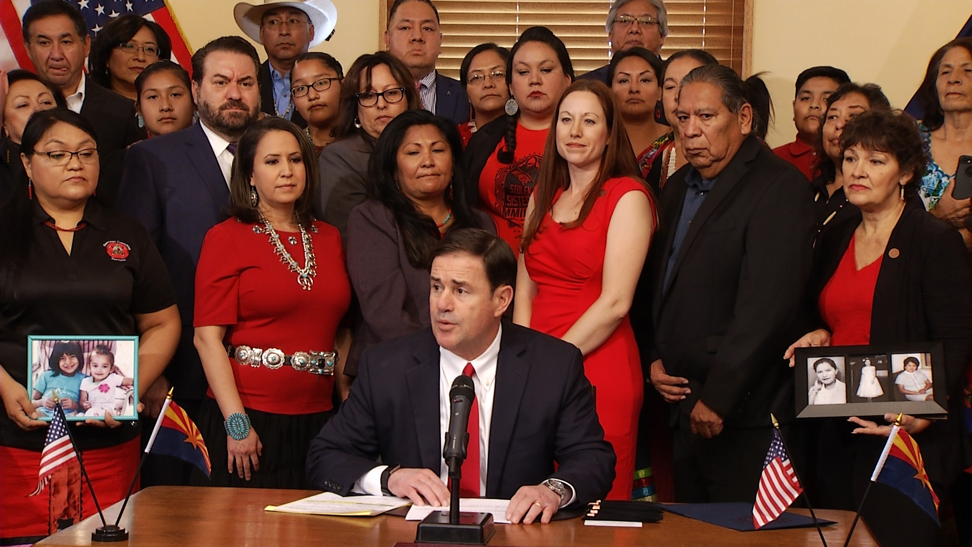 Gov. Doug Ducey holds up HB 2570, a law that will require the state to collect data on missing and murdered Indigenous women and girls, at the ceremonial signing Aug. 13, 2019.