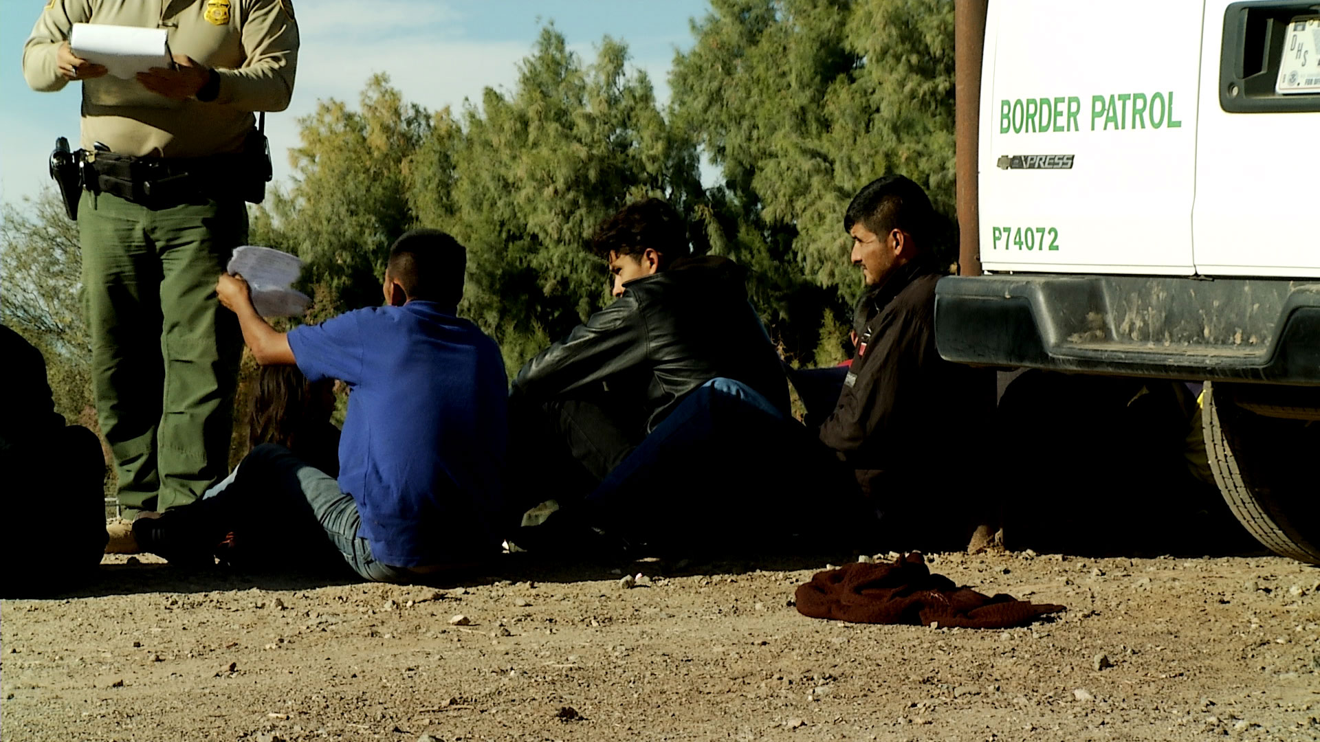 A Border Patrol agent begins processing a group of immigrants apprehended in Yuma in December 2018.