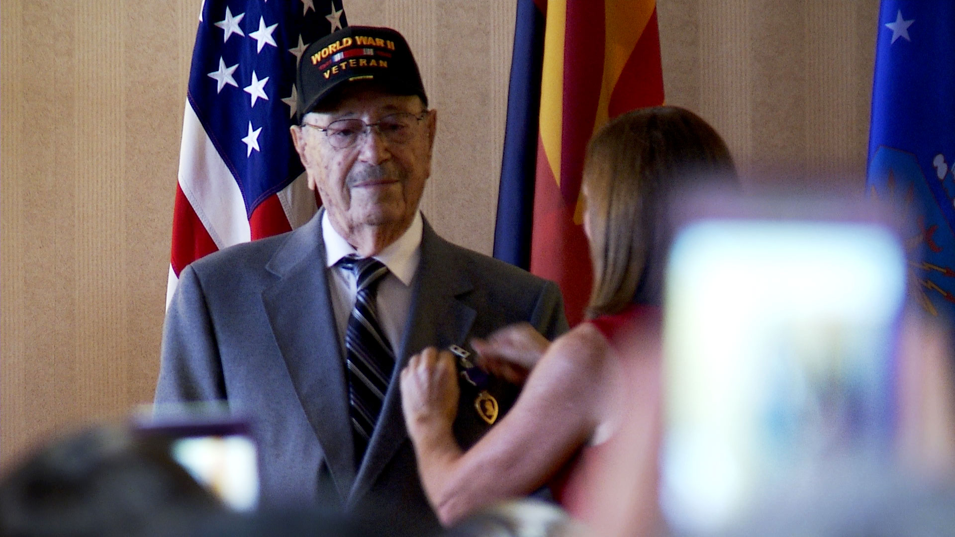 World War II veteran Walter Ram is presented with a Purple Heart with Oak Leaf Cluster by Sen. Martha McSally during a ceremony at Davis-Monthan Air Force Base on August 20, 2019.