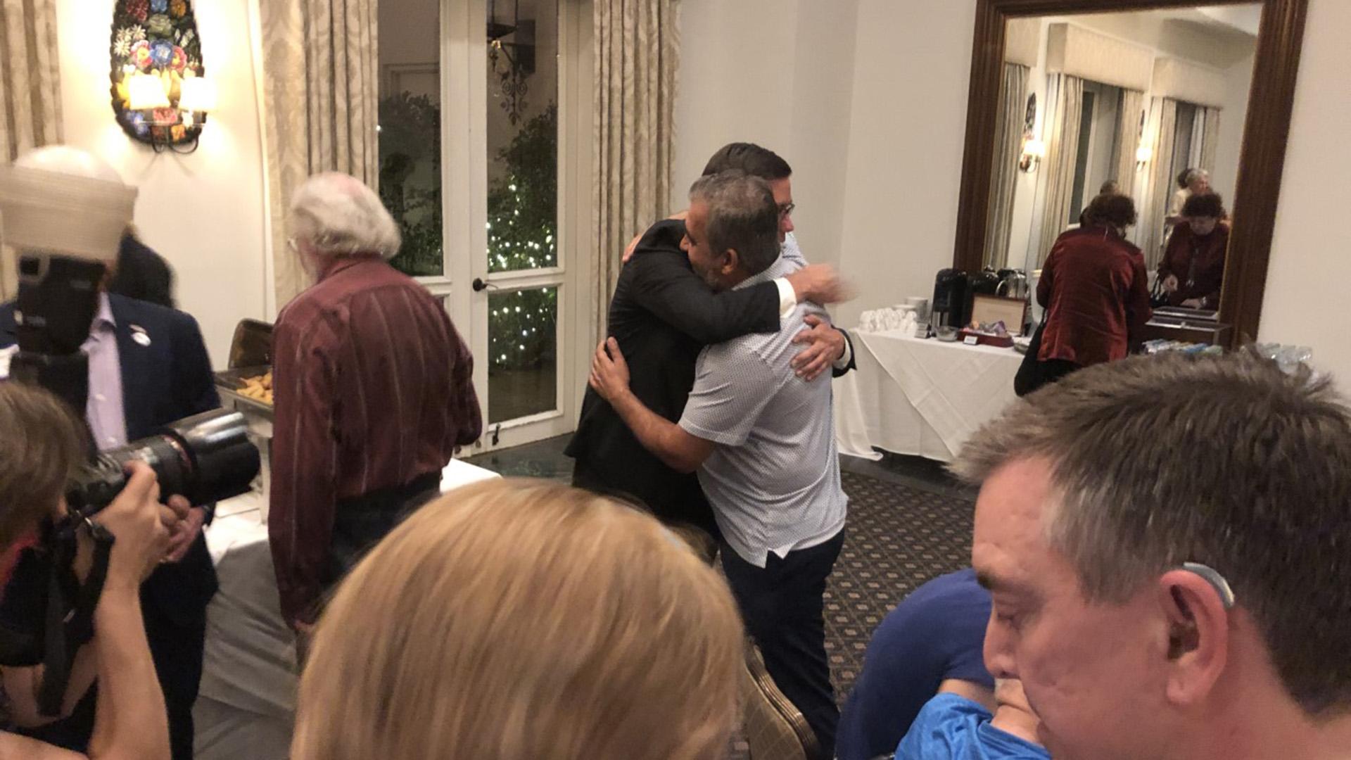 Farley hugs supporter