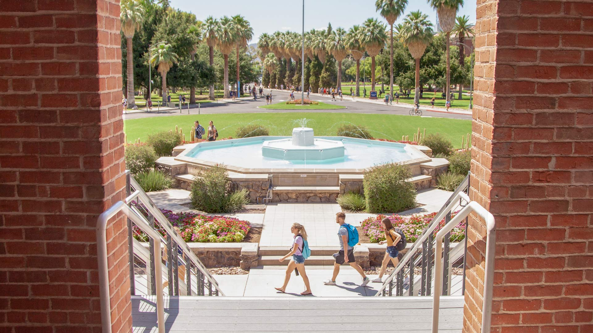 Students walk near the fountain at Old Main on the University of Arizona campus. From August 2019.