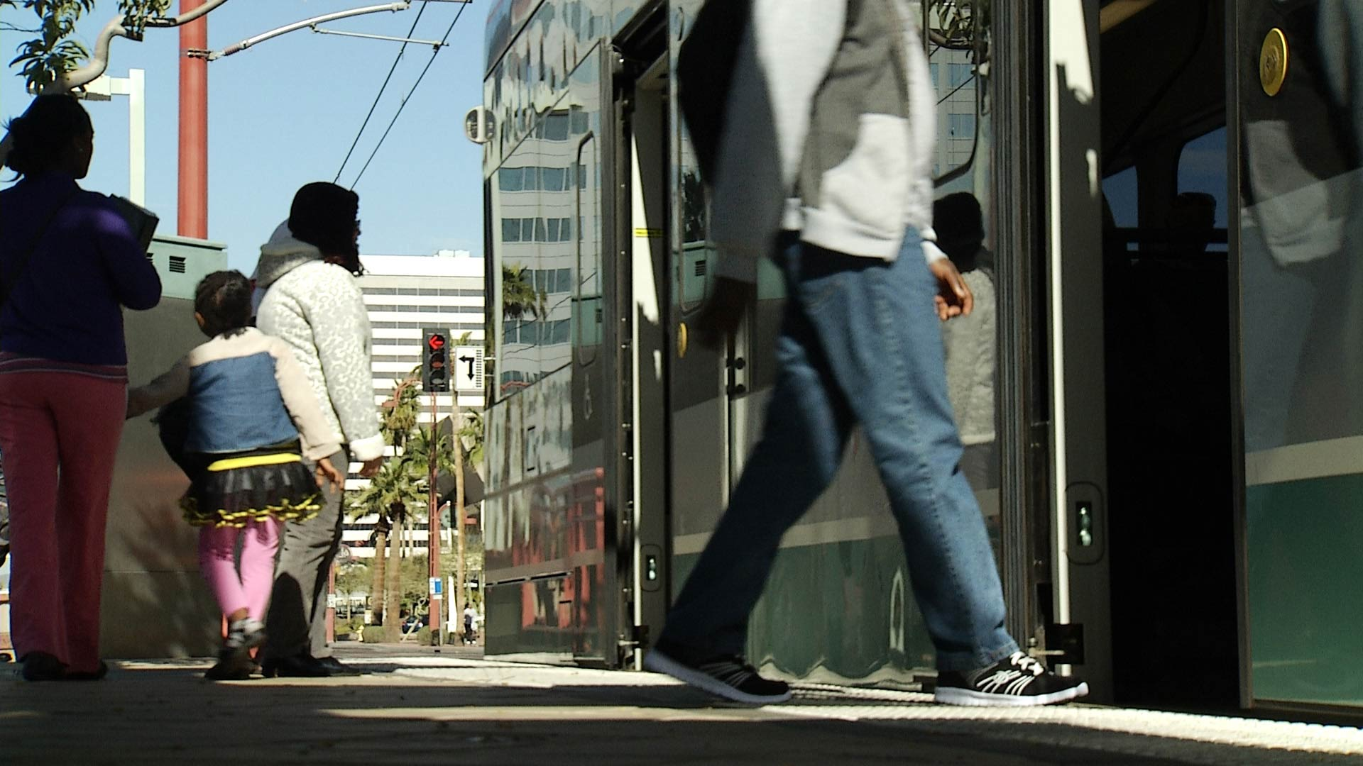 Riders board the Phoenix light rail.