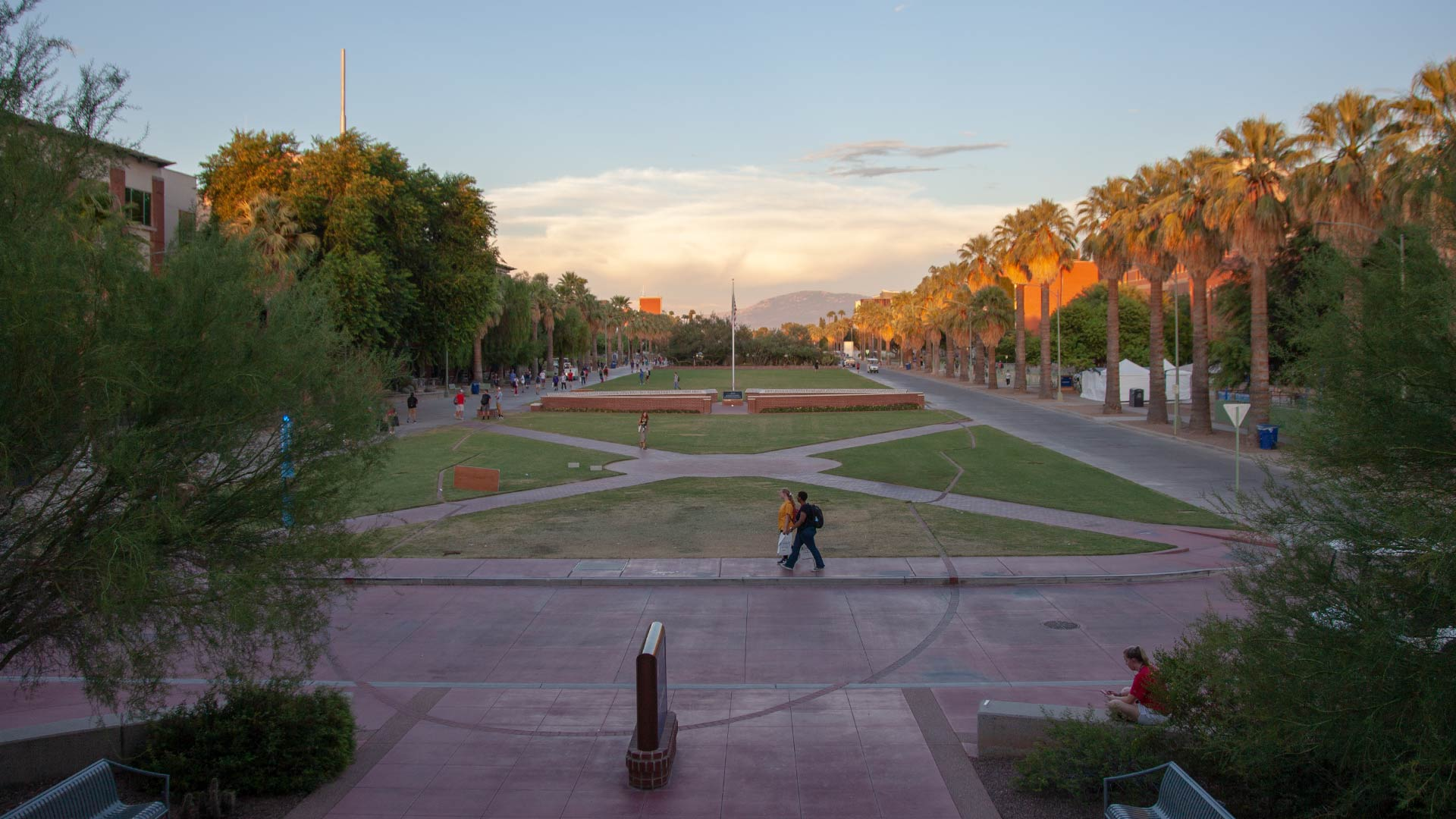 Students walk along the mall on the campus of the University of Arizona. From August, 2019.