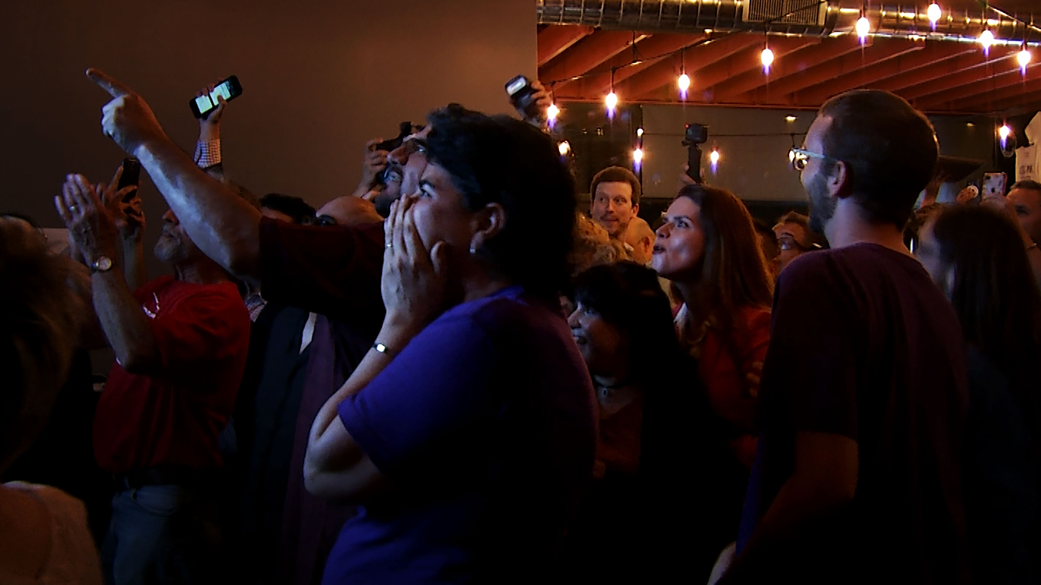Surrounded by her supporters, Tucson city councilwoman and Democratic mayoral candidate Regina Romero reacts to the results from Tucson's primary election at American Eat Company on August 27, 2019.