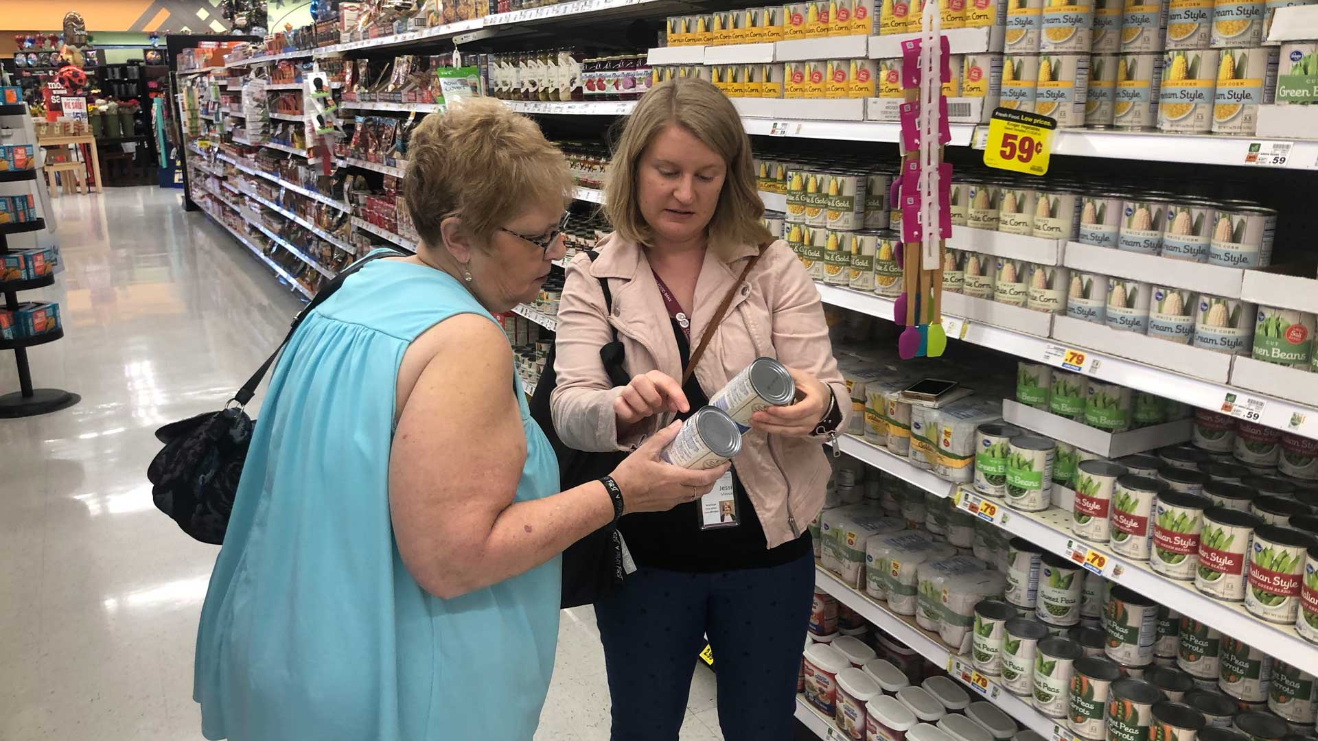 Jessica Sheava of the Foodbank of Southern Arizona talks nutrition and price with client Kathy Abbazia