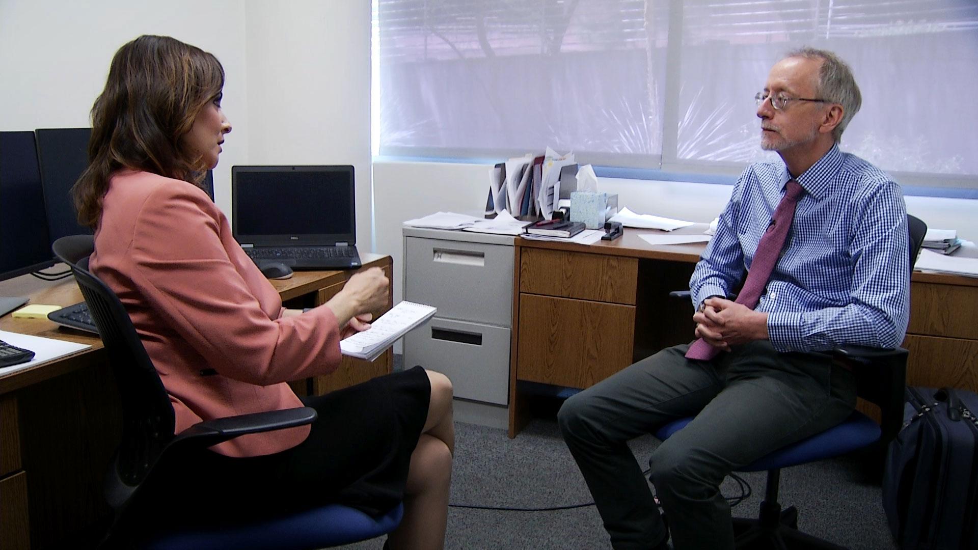Arizona 360 host Lorraine Rivera interviews UA Eller College of Management economist George Hammond in his office on August 6, 2019.