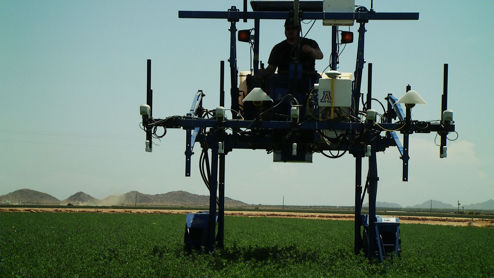 John Heun operates a mobile platform in an alfalfa field at the Maricopa Agricultural Center on July 26, 2019. The mobile platform is equipped with technology used for research in precision agriculture conducted by the University of Arizona College of Agriculture and Life Sciences.