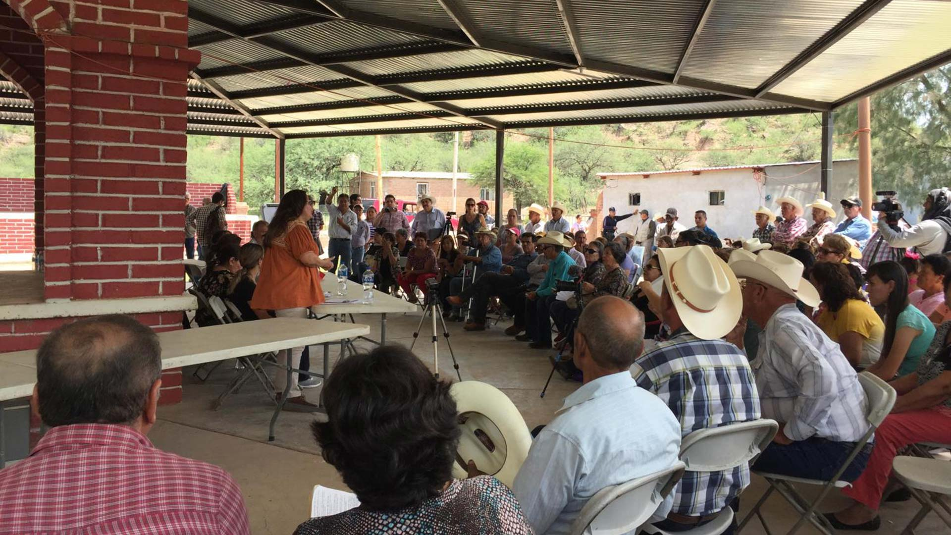 Mexican authorities meet with people affected by the 2014 mining spill in the Rio Sonora in the town of Bacanuchi, Sonora on Sept. 6, 2019.