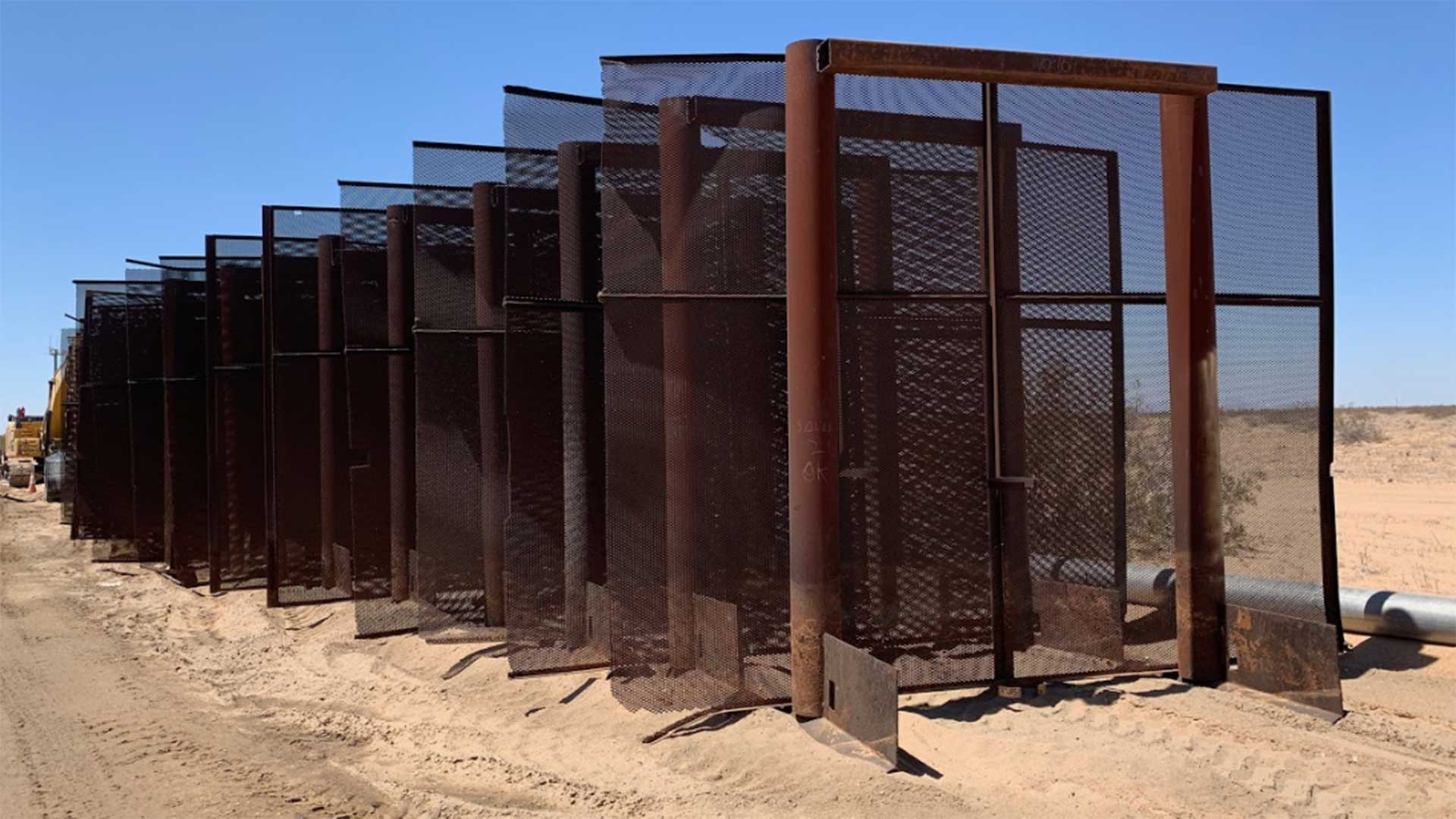 Parts of border wall staged for construction.