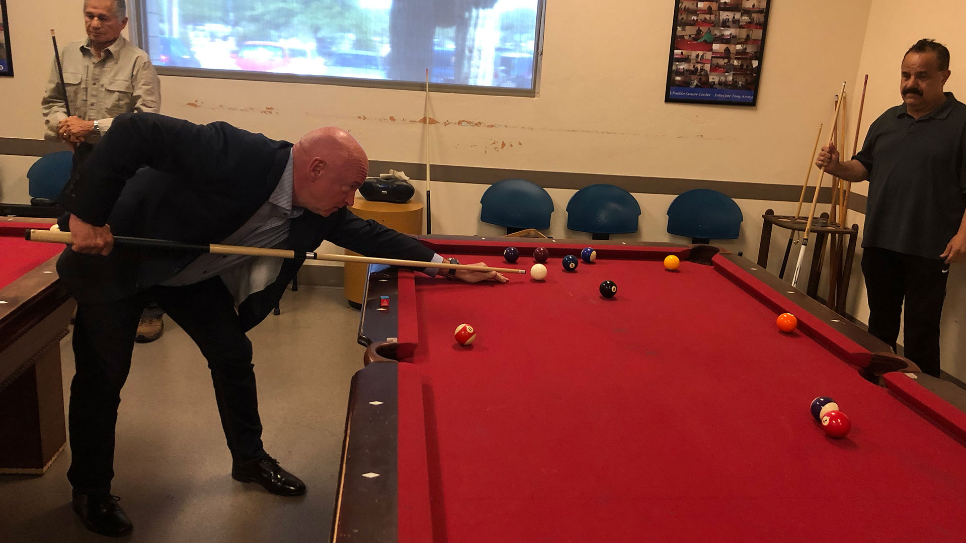 Democratic candidate for U.S. Senate Mark Kelly plays pool with senior citizens at the El Pueblo Center in Tucson, Sept. 17, 2019