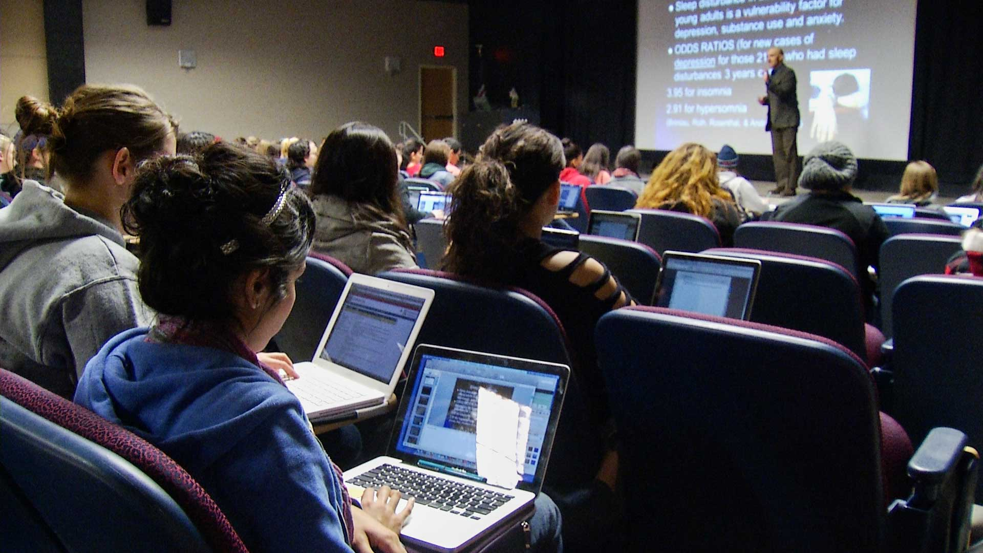 Students follow a lecture at the University of Arizona.