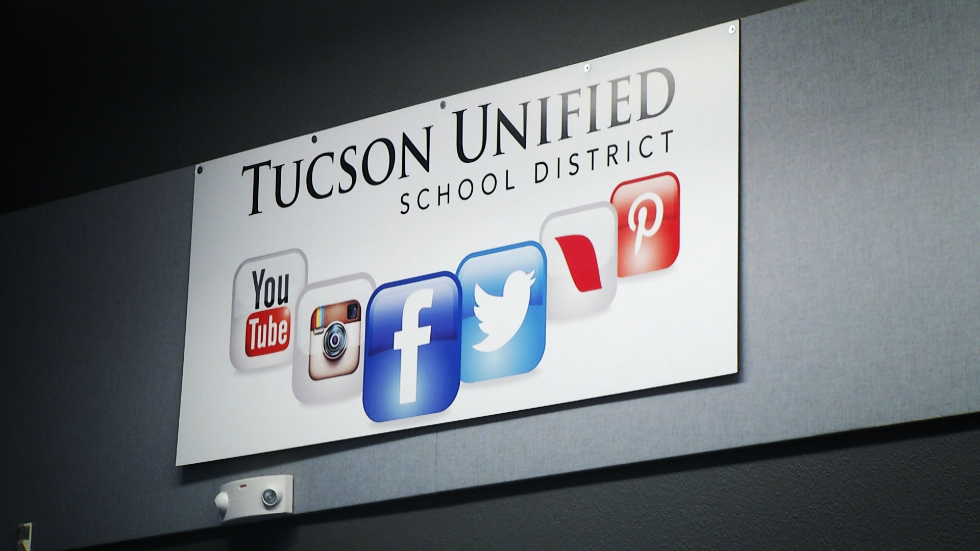 A banner for the Tucson Unified School District hangs in the school board's meeting room at the Duffy Community Center.
