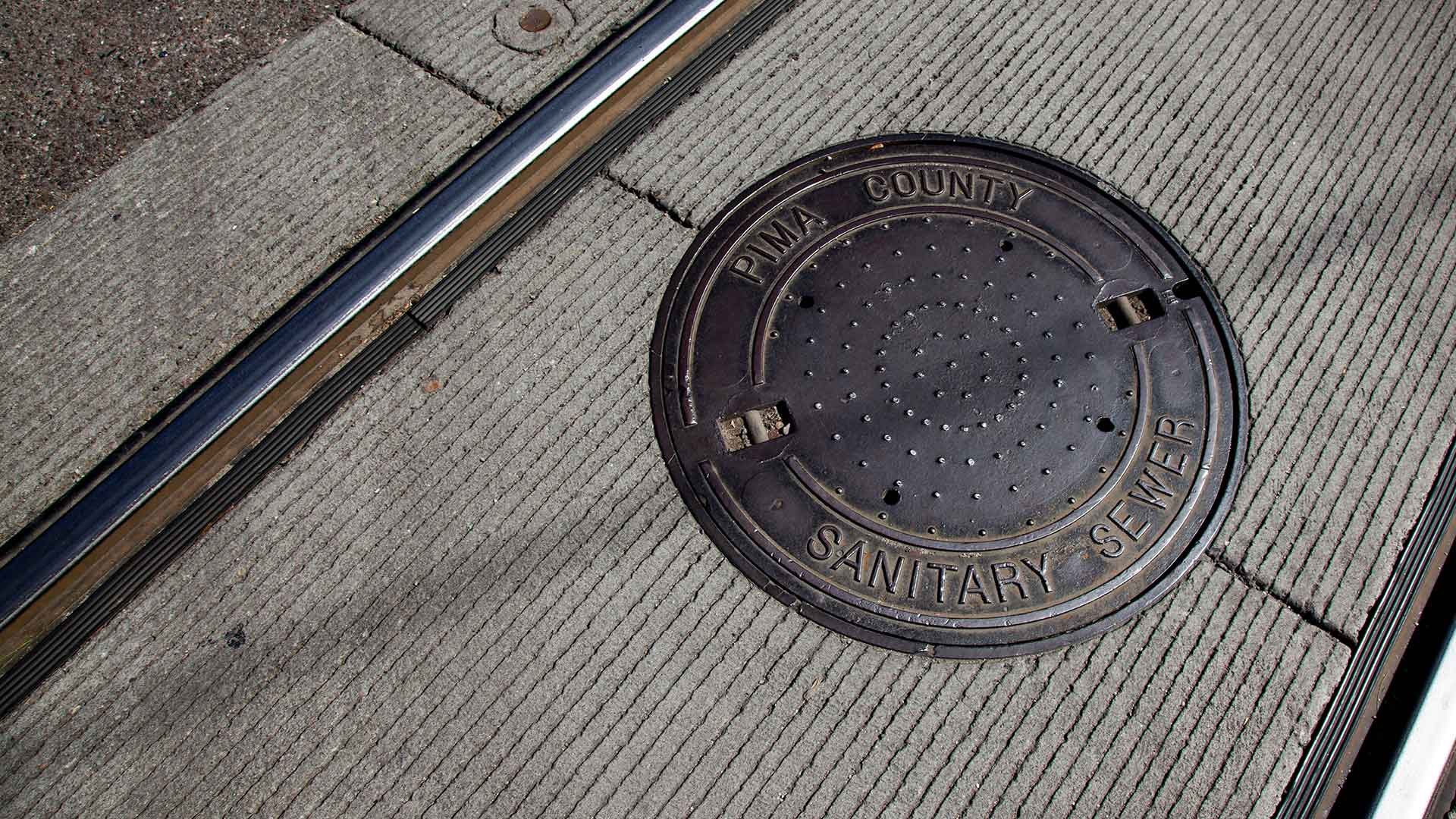 A Pima County sewer cover, along Tucson's streetcar line.