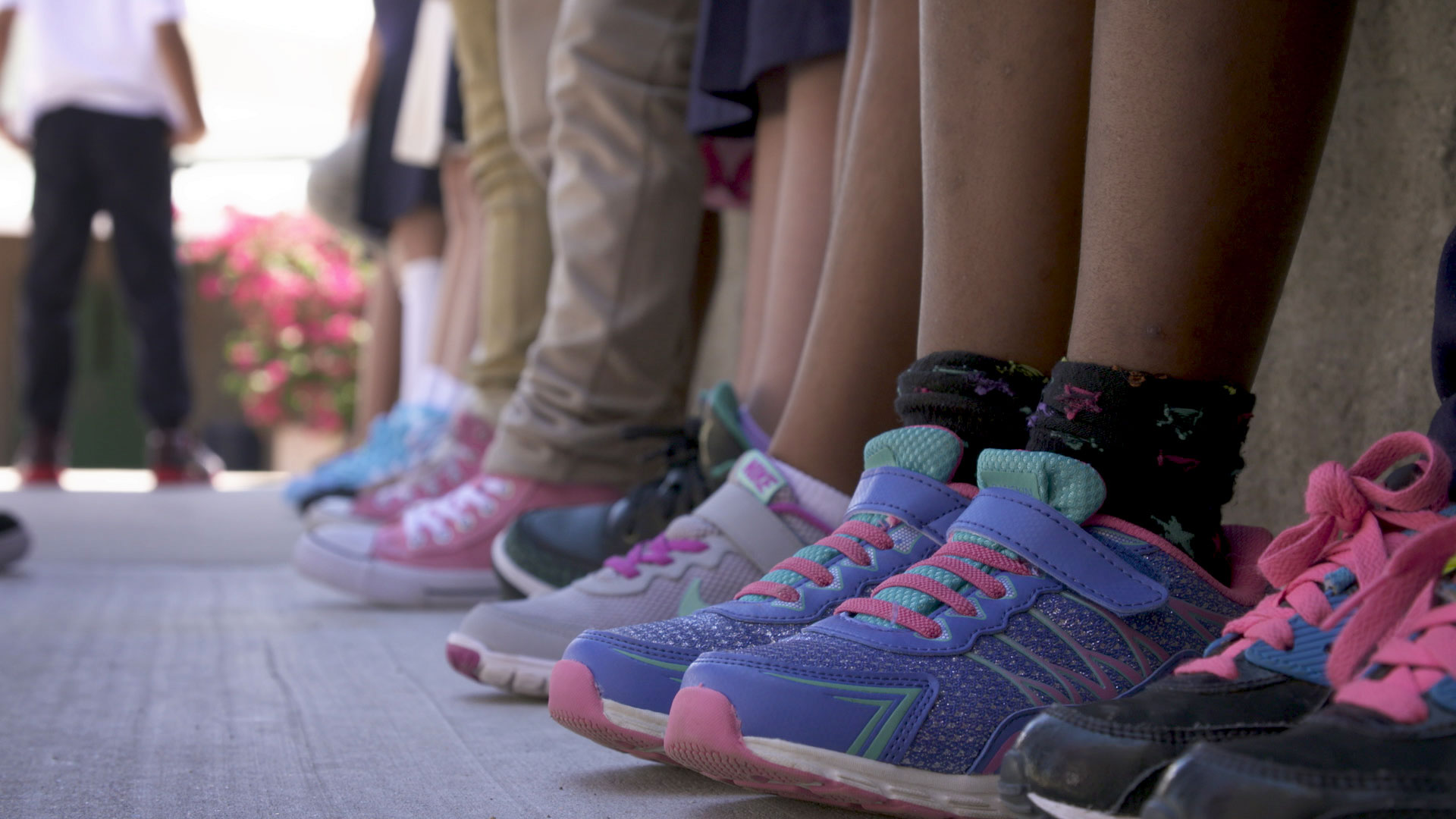 File image of children's shoes as they line up outside during school.