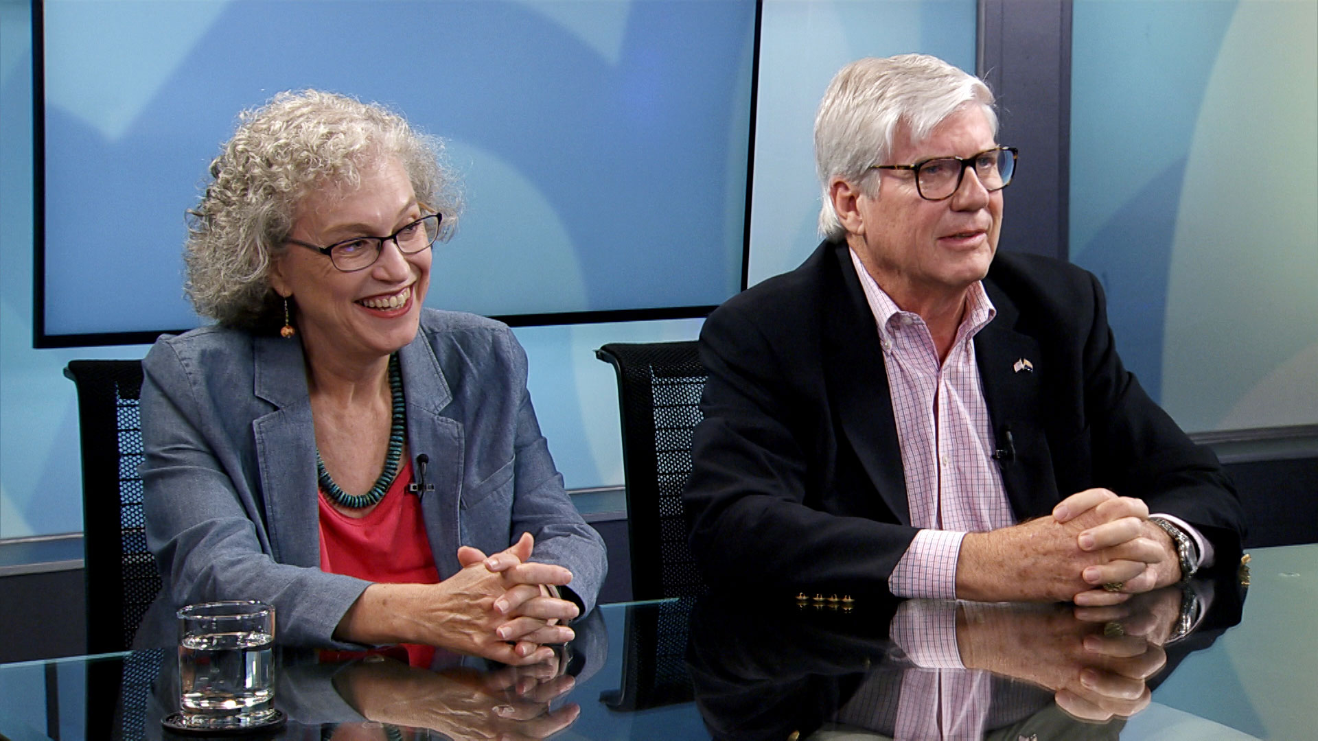 Pima County Democratic chair Alison Jones and Pima County Republican chair David Eppihimer sit for an interview at Arizona Public Media on September 3, 2019.