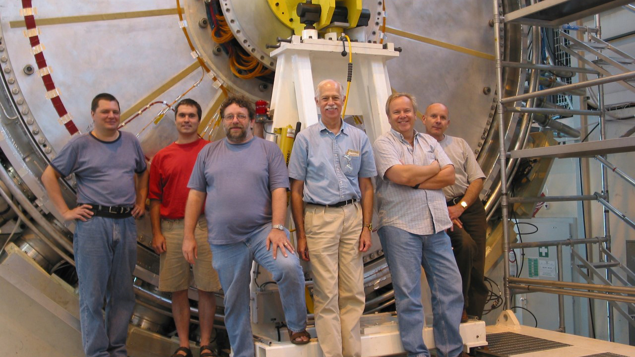 UA professor John Rutherfoord (3rd from right) with colleagues at the Large Hadron Collider.