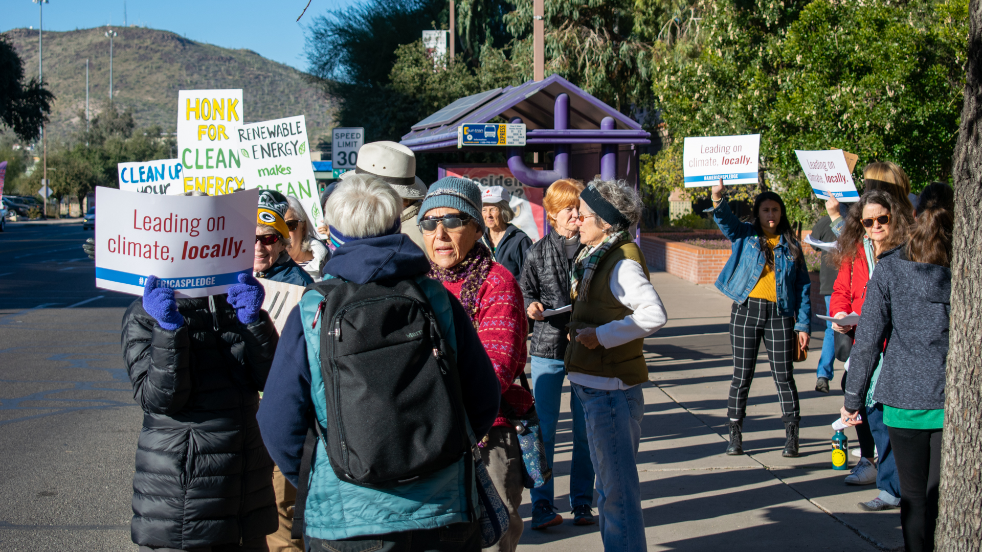 More than 20 people protested Tucson Electric Power's proposed rate hikes outside of the Arizona State Office Building in Tucson on Jan. 13, 2020.