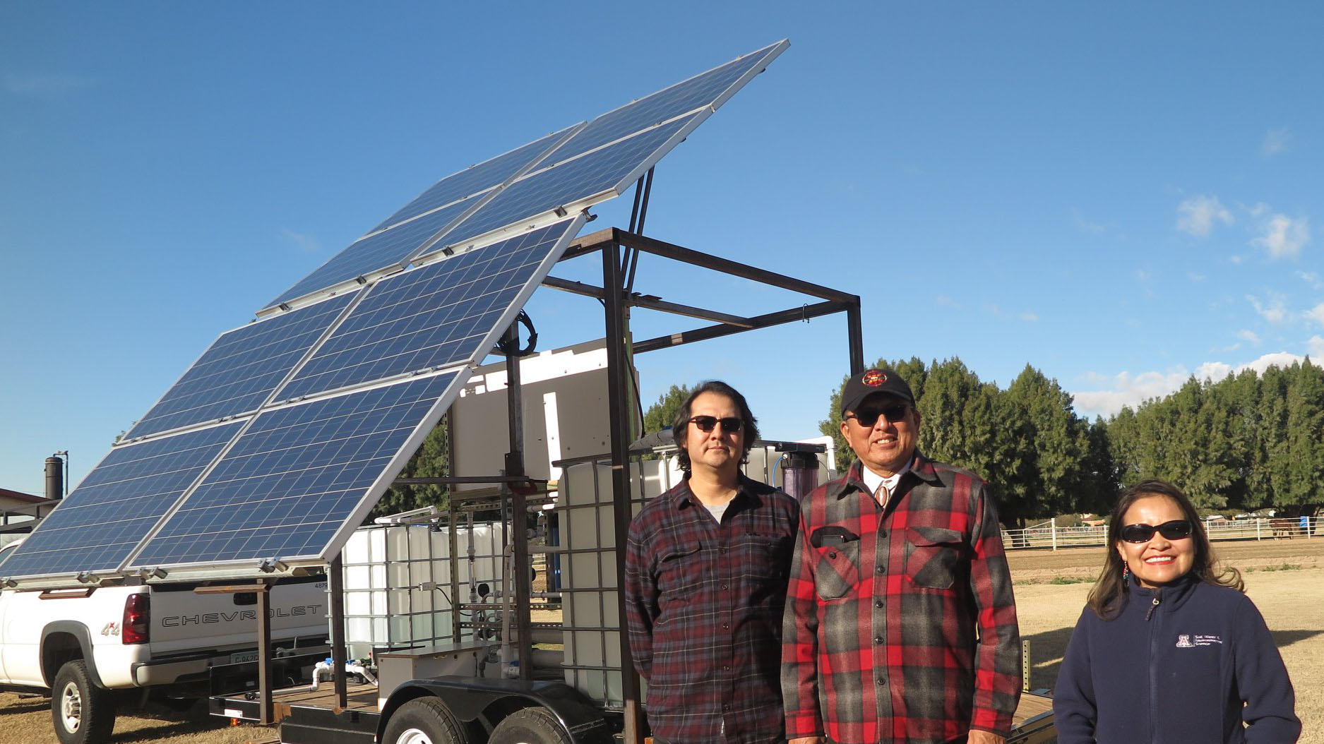 UA and National Science Foundation officials with a solar powered purification system on the Navajo Nation.