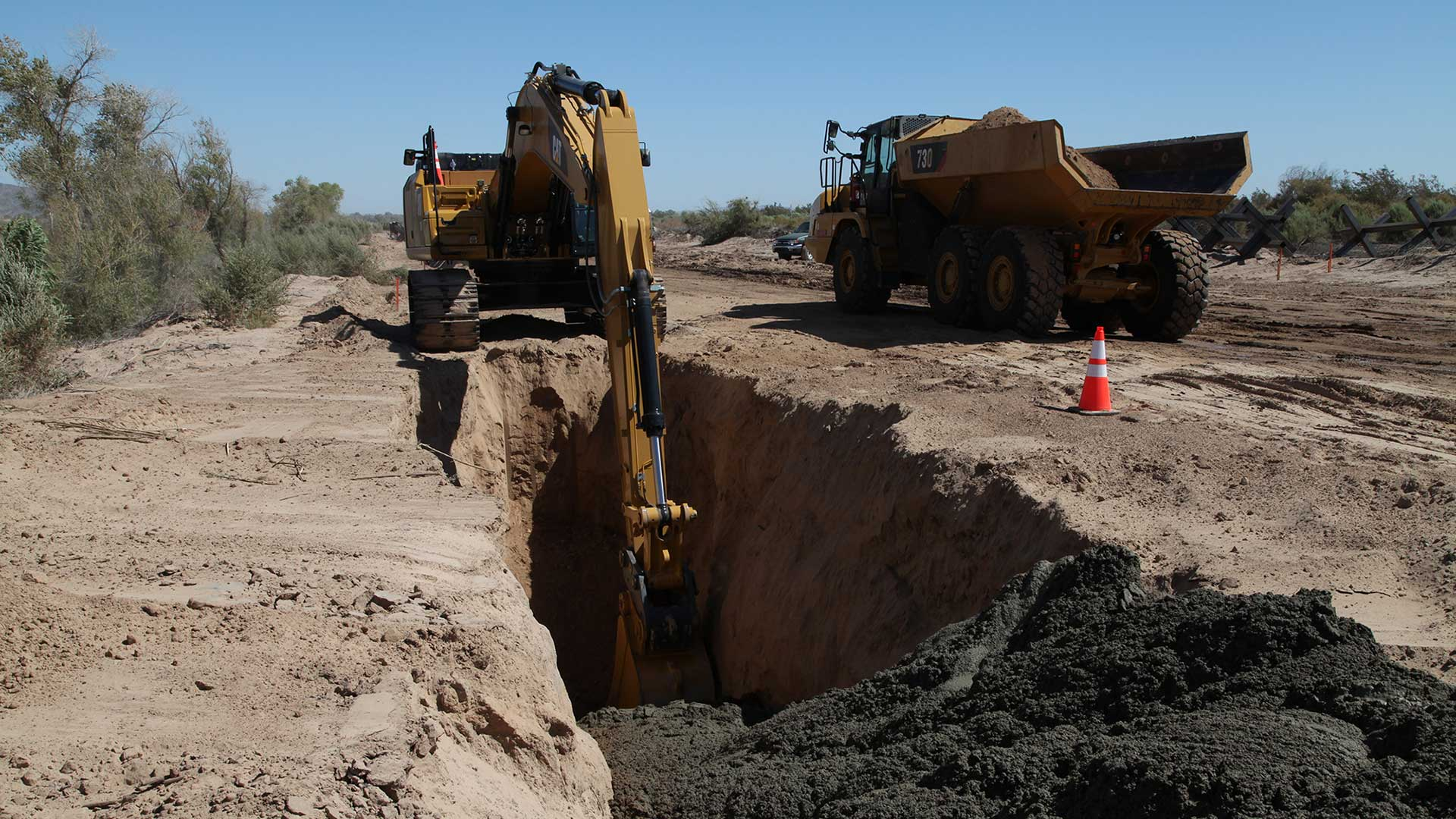 Army Corps of Engineers contractors pour concrete in August for the base of a new section of border wall near Yuma. The Department of Homeland Security waived environmental and other regulations on 90 miles of Arizona's border last year to smooth the way for border wall construction projects.