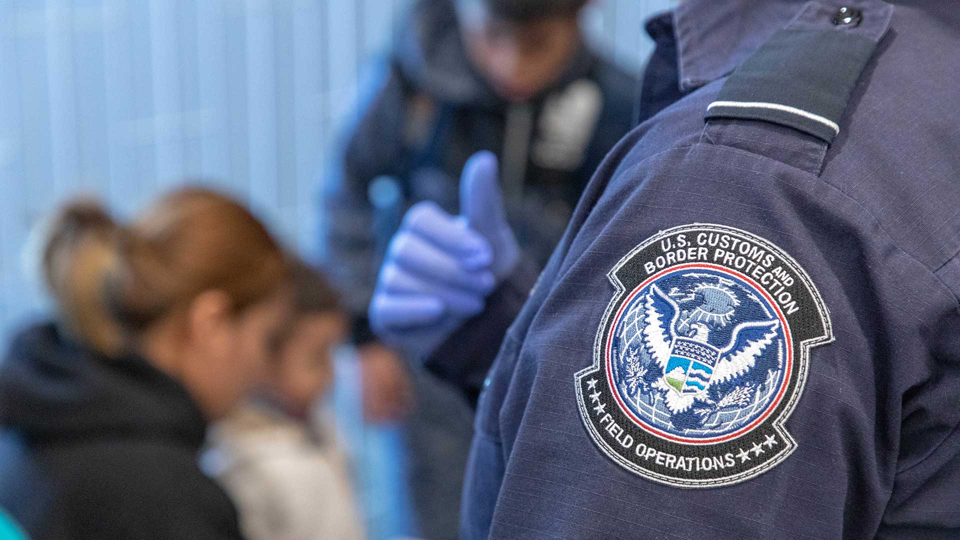Migrants and Customs and Border Protection officers at the San Ysidro Port of Entry, November 2018.