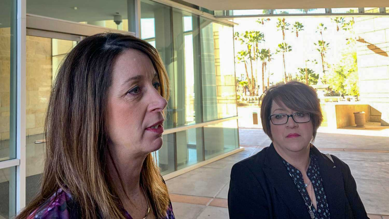 Kelly Willis and Michelle Balogh, Brian Terry's sisters, speak out the U.S. District Courthouse in Tucson following the life sentence imposed on Heraclio Osorio Arellanes.