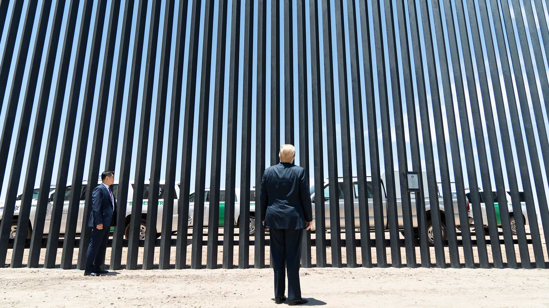 President Donald Trump stands at a section of border wall on the southern border near Yuma, June 23, 2020.