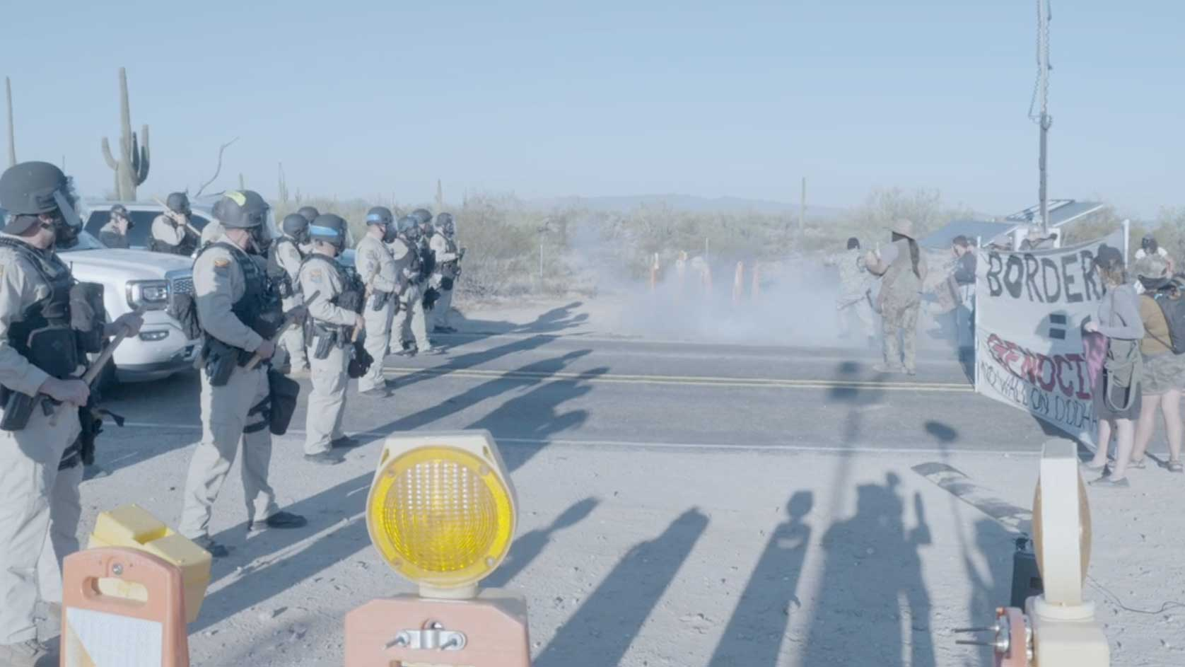 A line of DPS officers forms in front of an Indigenous Peoples' Day Protest north of the Lukeville Port of Entry on Oct. 12, 2020.