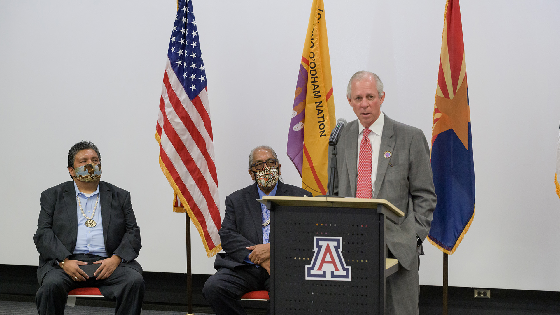 Tohono O'odham Nation Legislative Council Chairman Timothy Joaquin, Tohono O'odham Nation Chairman Ned Norris Jr., and University of Arizona President Robert Robbins at the press conference announcing the nation's donations to the UA and Arizona State University to further COVID-19 research Oct. 19, 2020.