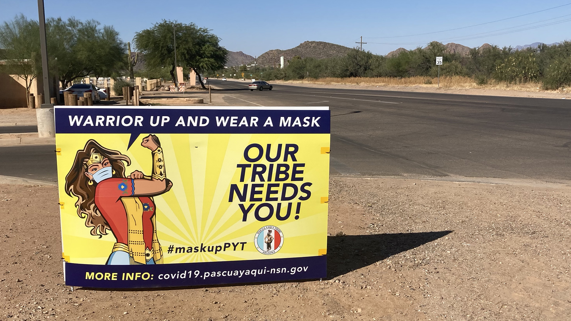 Sign in the Pascua Yaqui Tribe's lands urging tribal members to wear a mask during the COVID-19 pandemic.