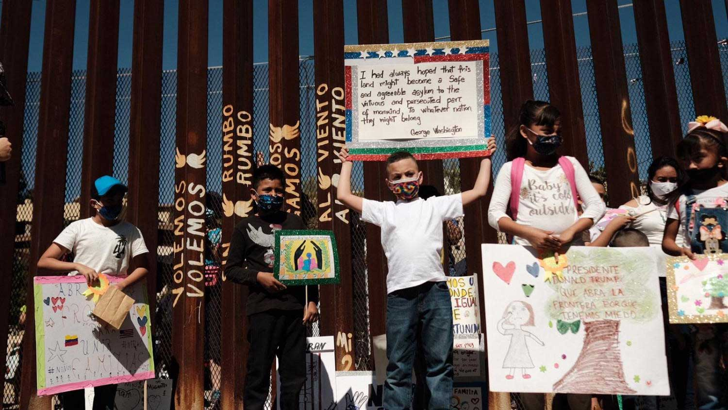 Children who are waiting for asylum in the United States with their families in Nogales, Sonora, marched to the border wall Wednesday, Oct. 21, 2020, to ask the United States to open the border to them.