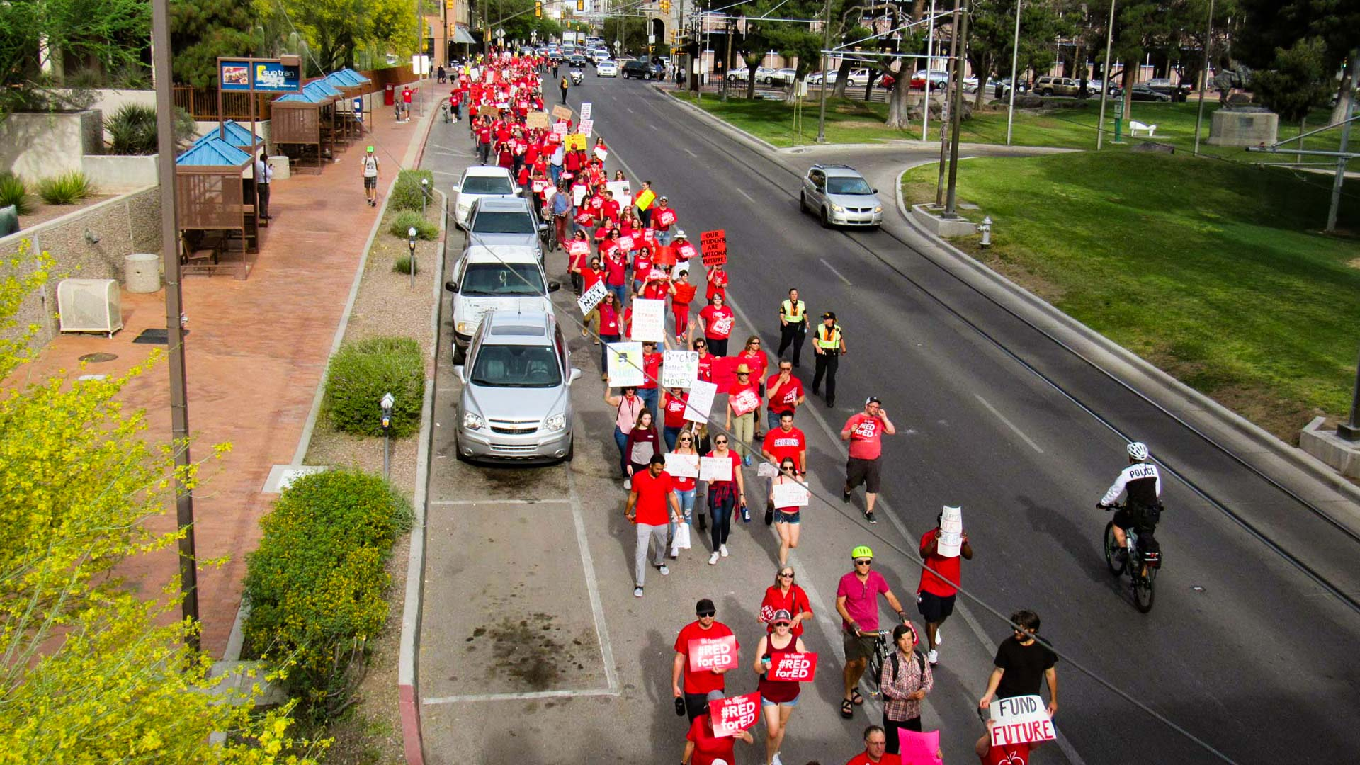 Educators march in downtown Tucson in 2018 calling for better teacher pay and education funding in Arizona. This year's Proposition 208  aims to make up for lagging education funding in the state by taxing the wealthy.