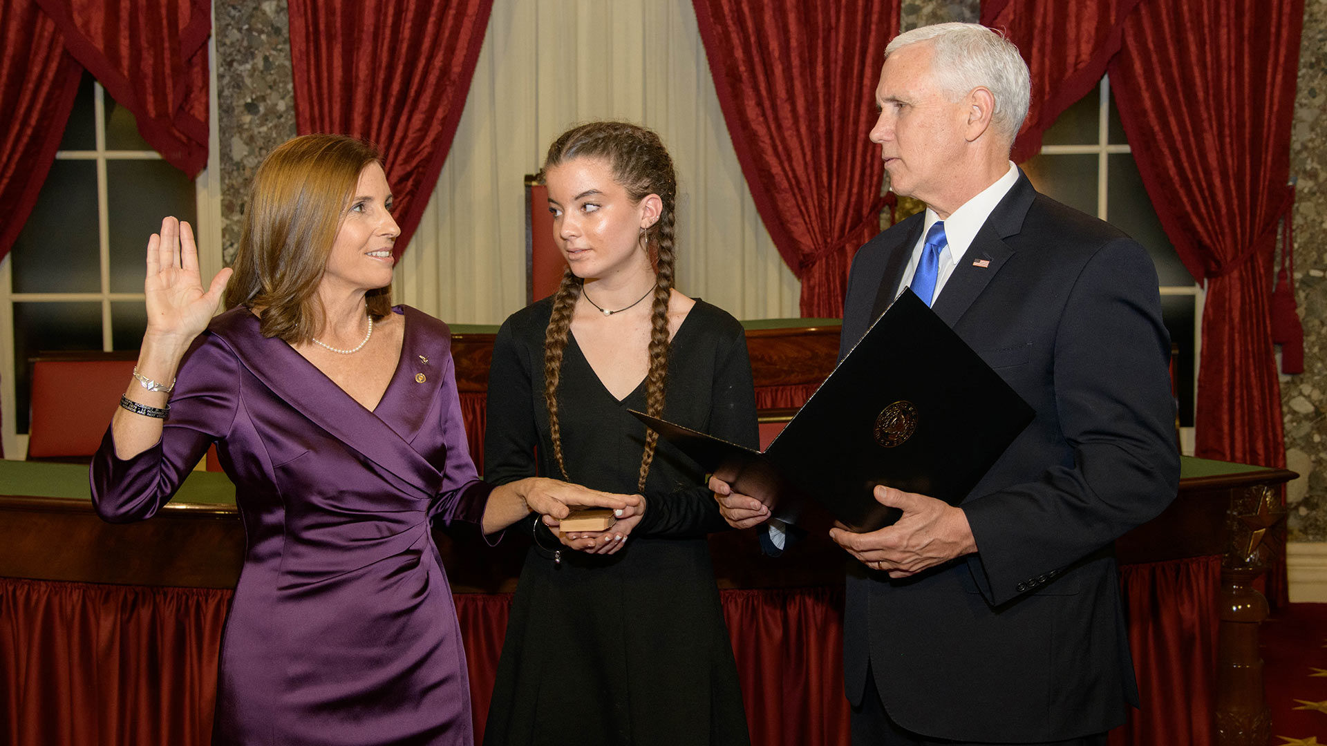 Sen. Martha McSally takes the oath of office for the U.S. Senate, January 4, 2019.  Vice President Mike Pence administered the oath while McSally's niece, Ella, held the bible.  McSally borrowed the bible for the University of Arizona Special Collections.  The copy of the New Testament was recovered from the body of an unknown sailor killed during the bombing of the U.S.S. Arizona in Pearl Harbor.