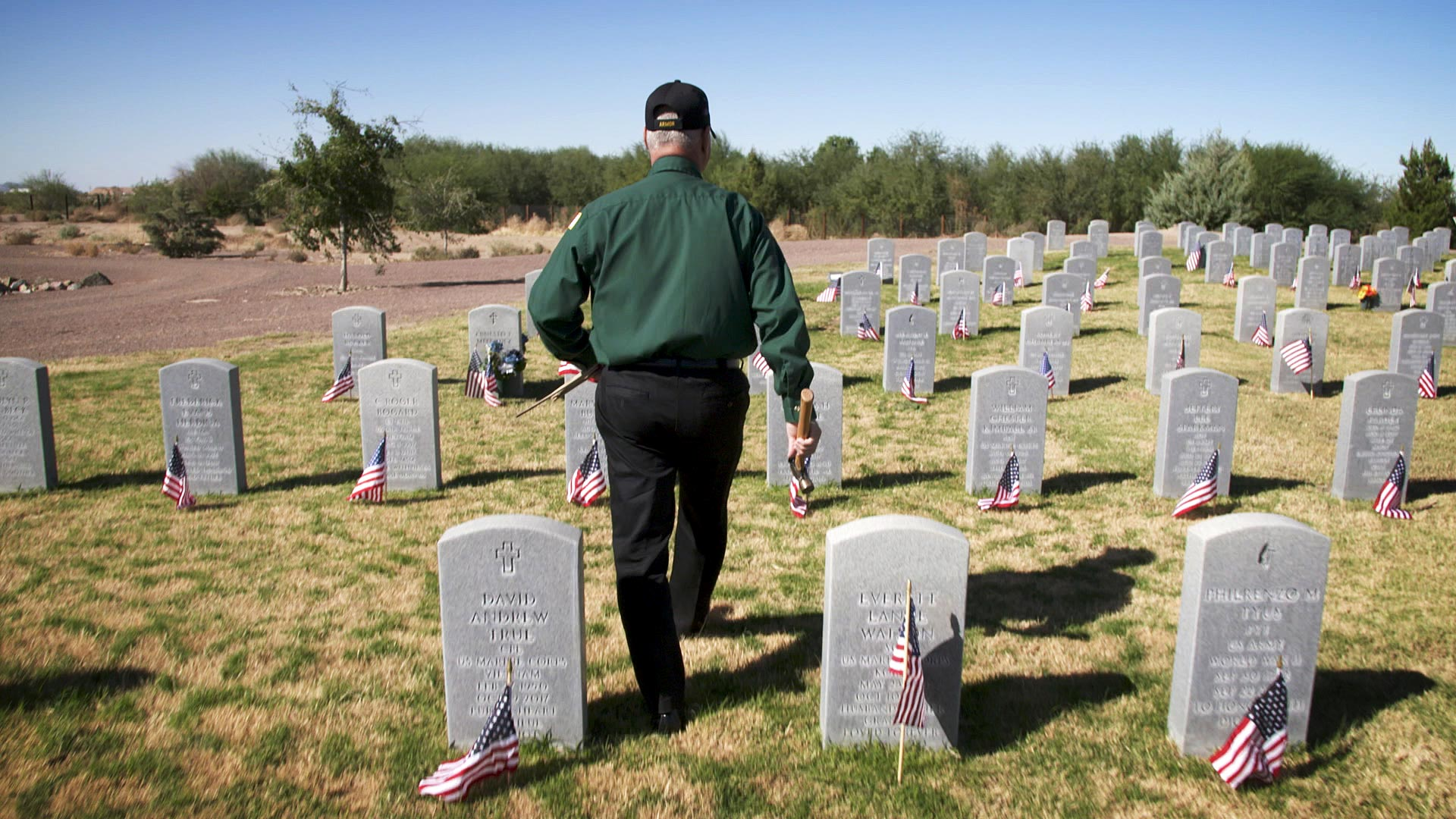 Retired Lt. Col. Ken Robinson walks through the Arizona Veterans' Memorial Cemetery at Marana where he planted flags at the graves of service members ahead of Veterans Day on Nov. 10, 2020.