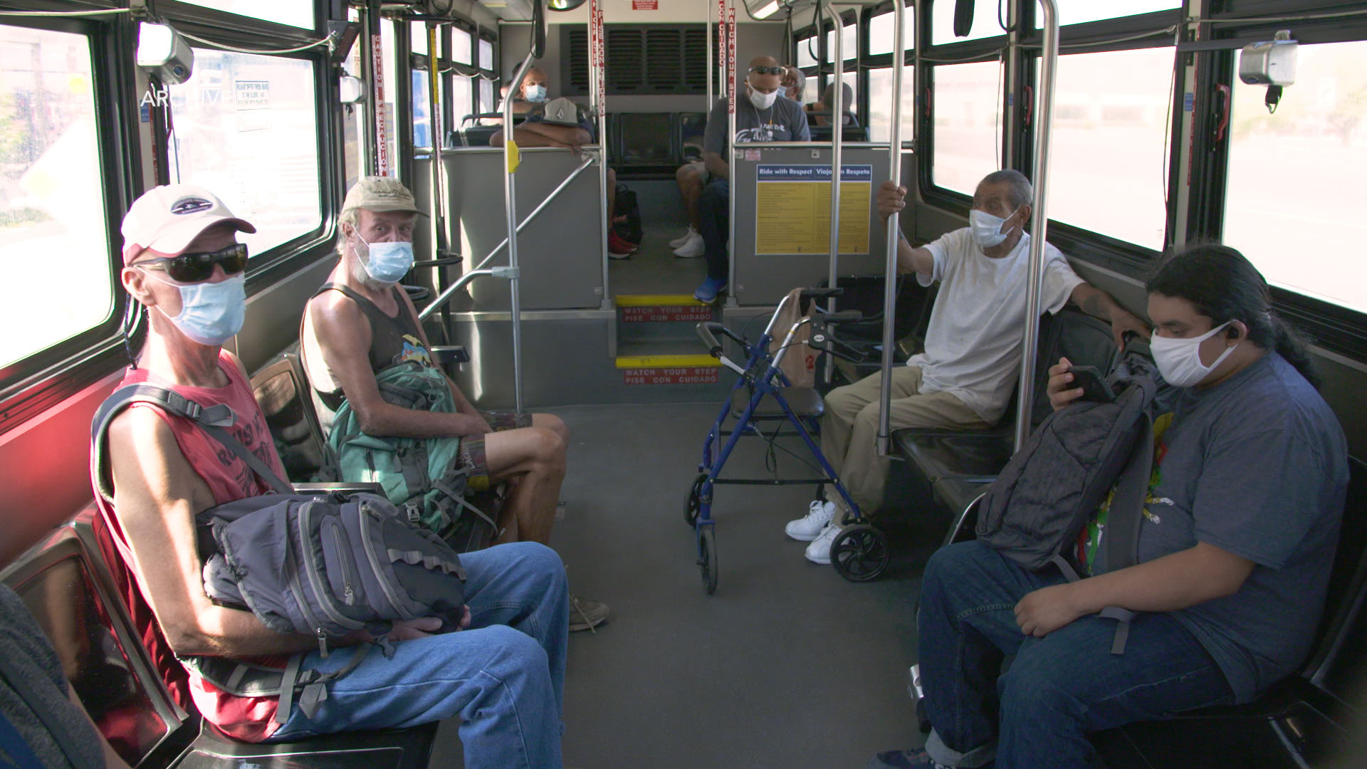 Community members travel by bus during the COVID-19 pandemic.