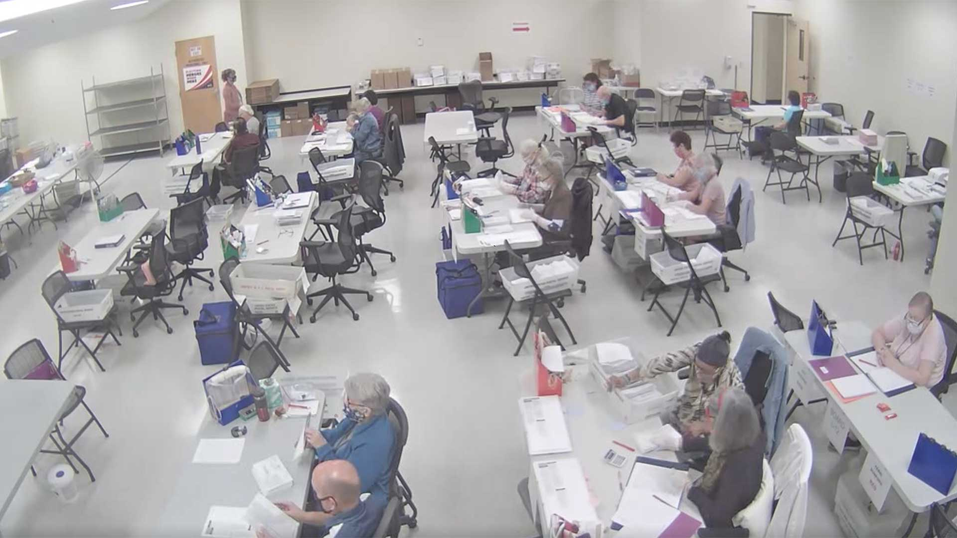 Pima County election workers process ballots the morning of Nov. 5, 2020 in this still image from the live feed of the early/provisional ballot processing room.