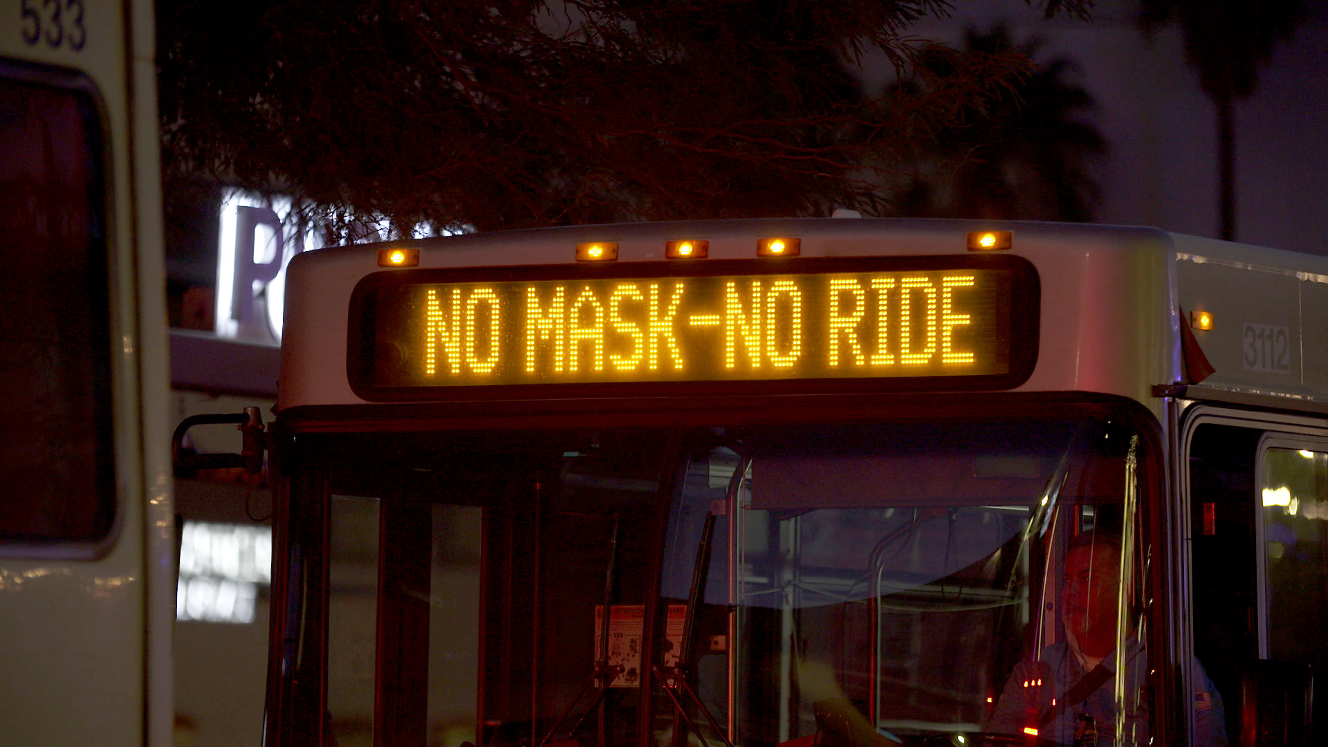 A Sun Tran bus in downtown Tucson notifies passengers that a mask is required to board. November 2020.