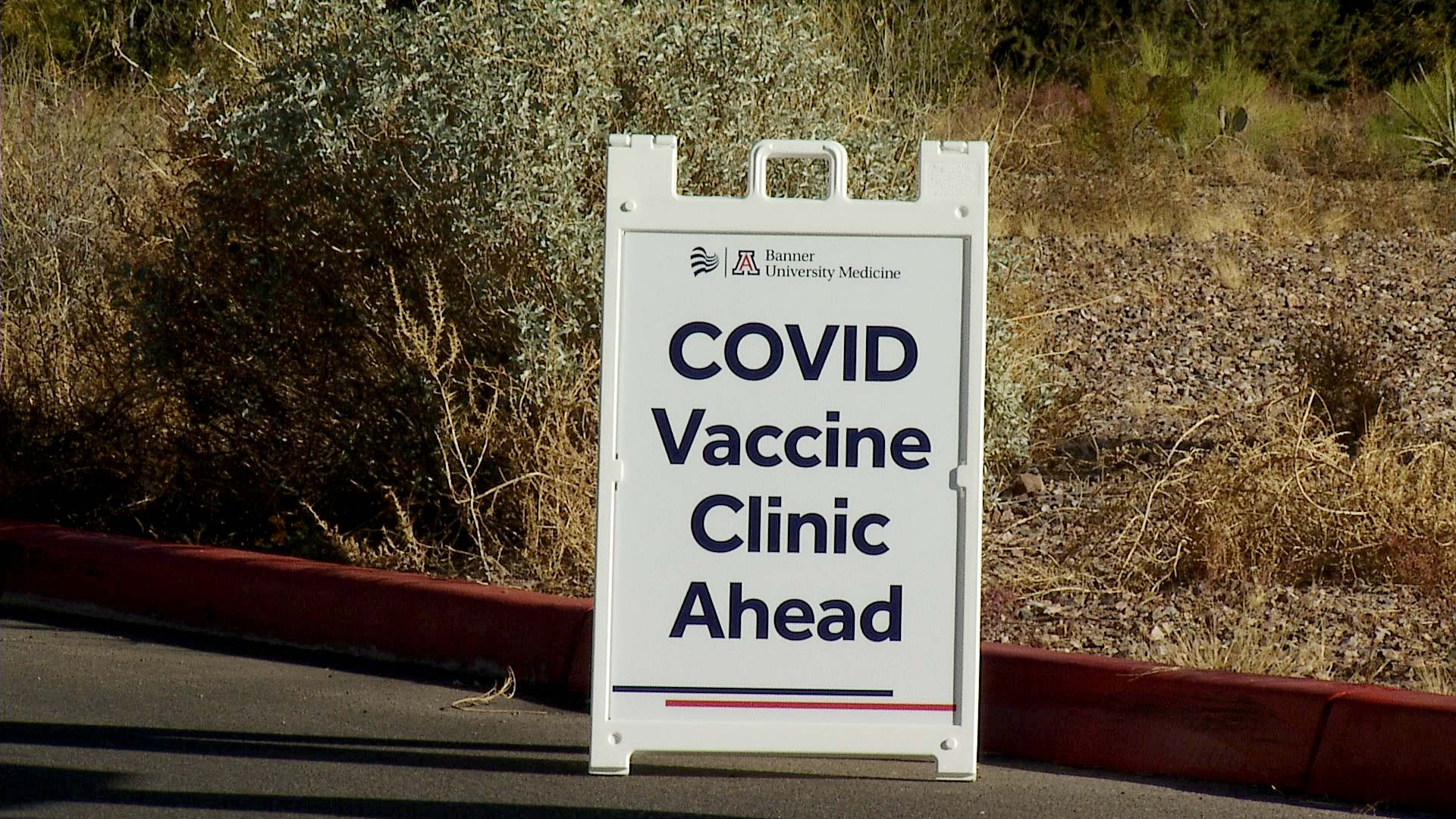A sign outside Banner - University Medicine North in Tucson for the hospital's COVID-19 vaccine distribution site. Dec. 17, 2020.