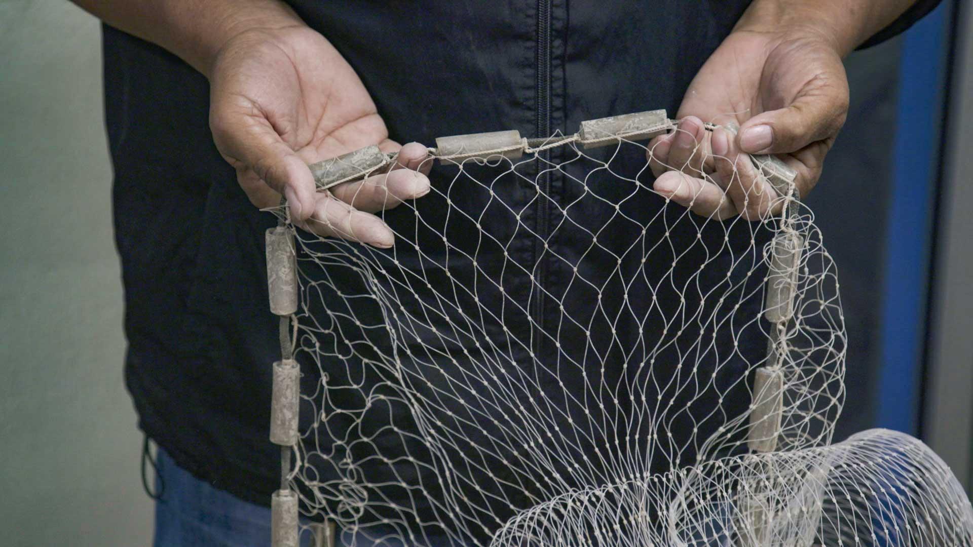 Sea Shepherd's JP Geoffroy demonstrates a gill net.
