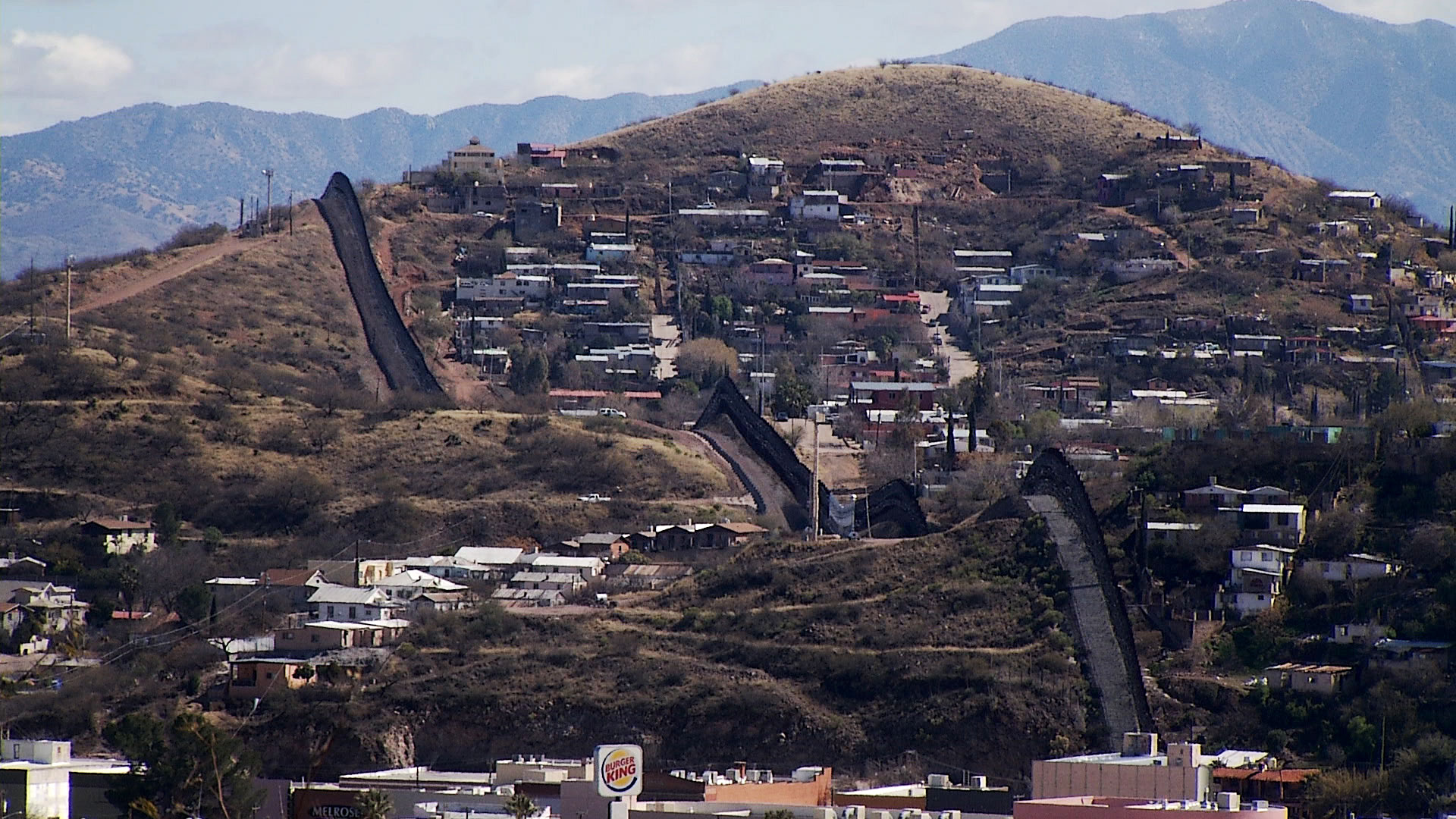 From Nogales, Arizona, a view of the city and its border wall with Nogales, Sonora.