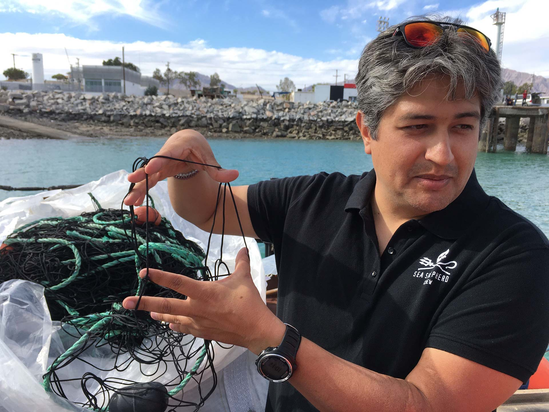 Sea Shepherd's JP Geoffroy demonstrates a gill net.