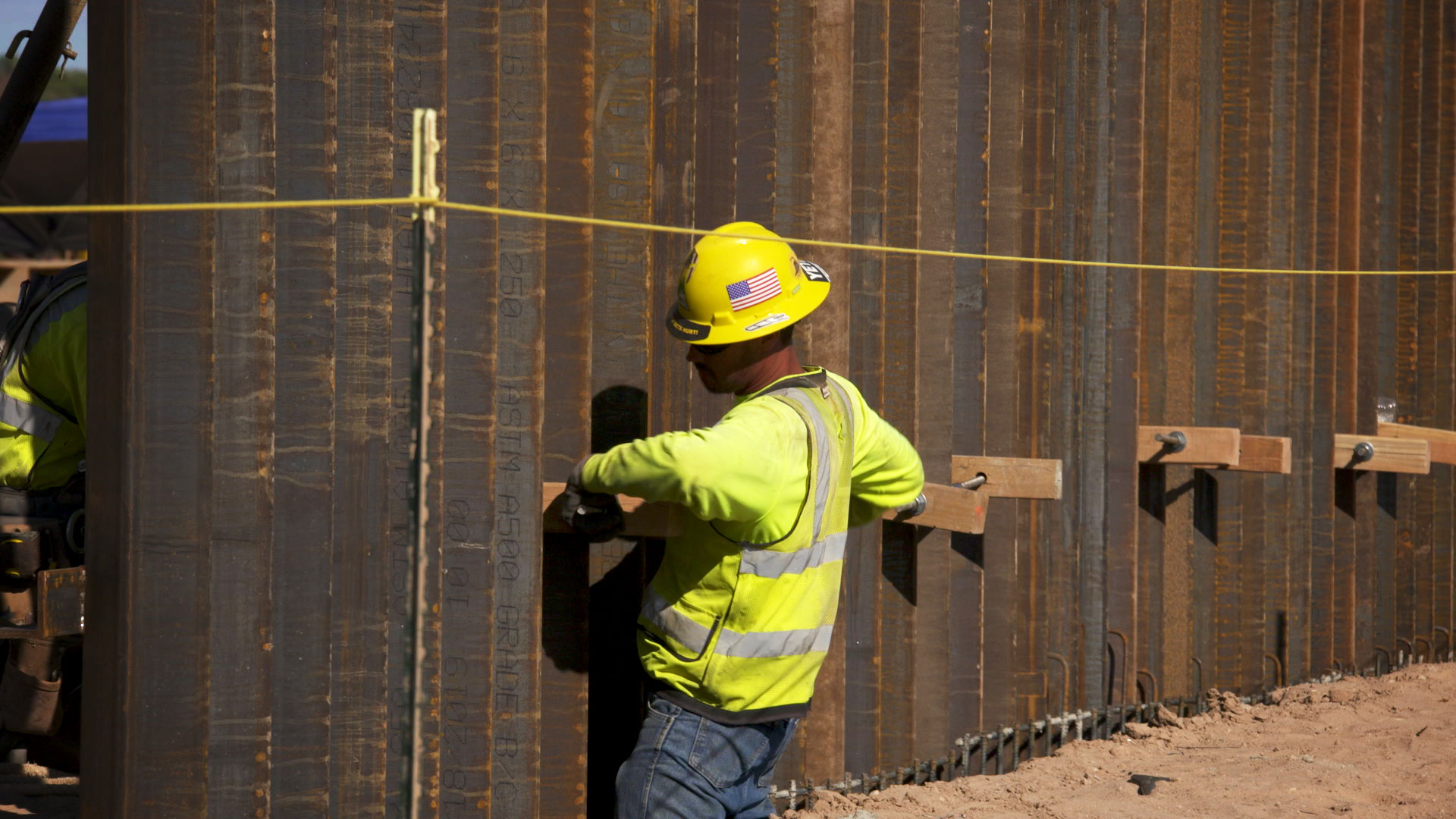 A construction worker works on installing 30-foot bollard fencing along Arizona's border with Mexico in Organ Pipe Cactus National Monument, February 2020.