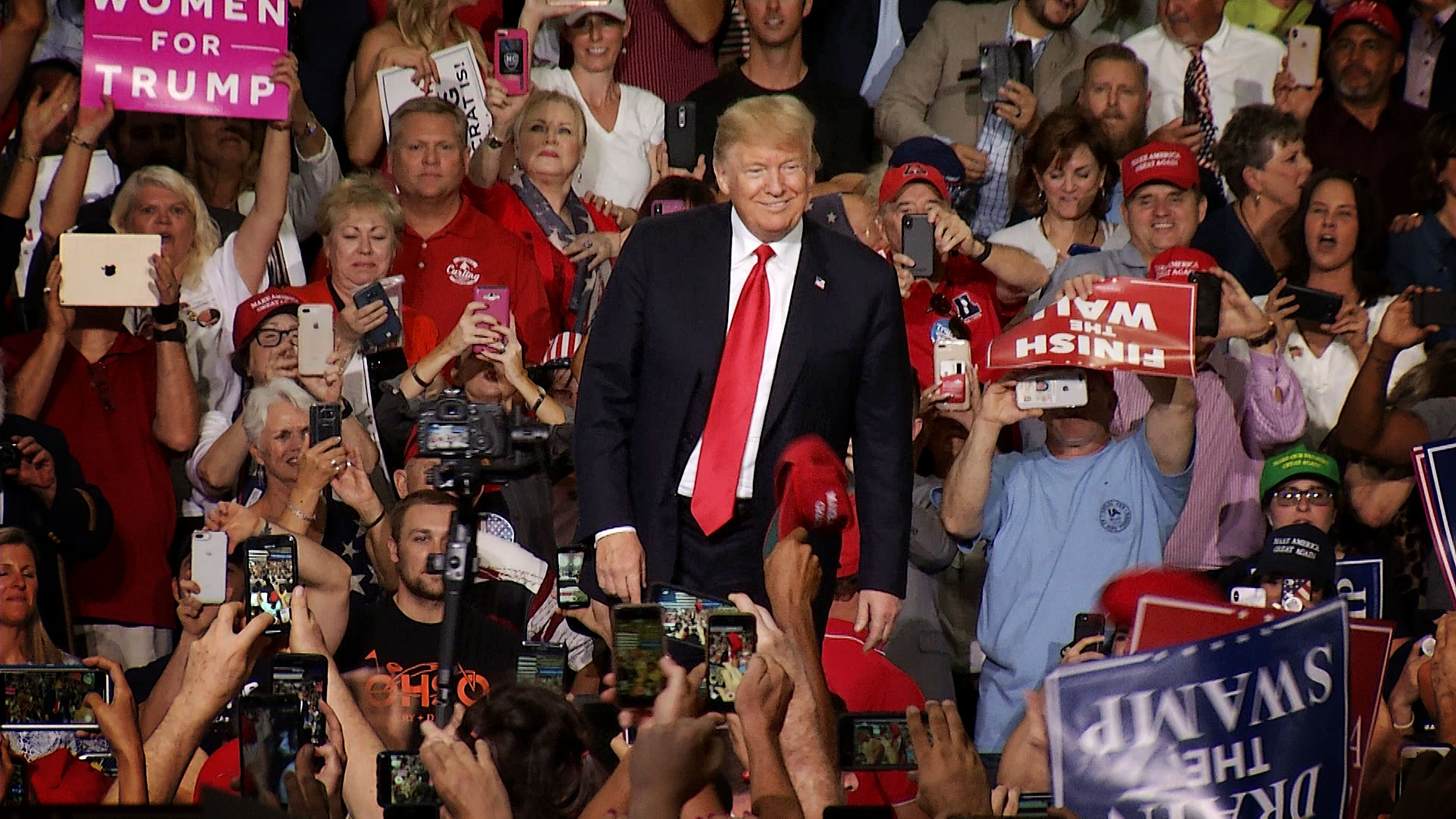 President Donald Trump greets the crowd at his rally at the Phoenix-Mesa Gateway Airport in October 2018.