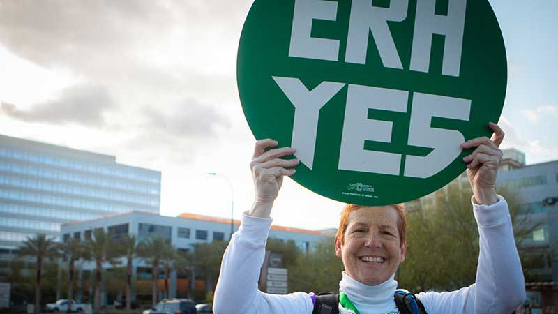 In this March 2019 file photo, Cindy Harrison rallies in Phoenix in support of the Equal Rights Amendment. Arizona has never approved the ERA, one of just 12 states not to have done so, but Virginia's recent ratification led the U.S. House to remove a deadline for states' ratification in hopes of reviving the amendment.