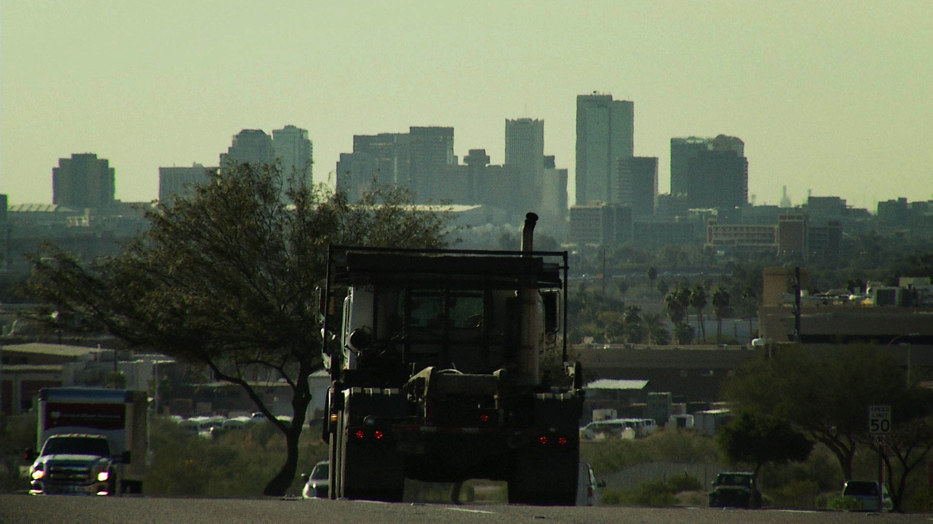 Traffic in Phoenix with the city's downtown skyline in the distance.