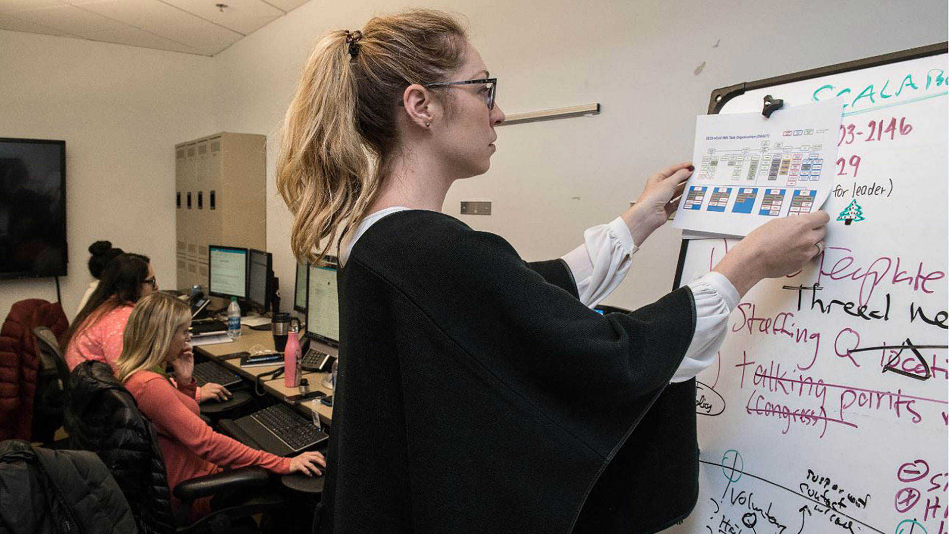 Workers in the Centers for Disease Control and Prevention's Emergency Operations Center, which was activated to work with the World Health Organization, federal, state and local public health agencies and others responding to the novel coronavirus outbreak.