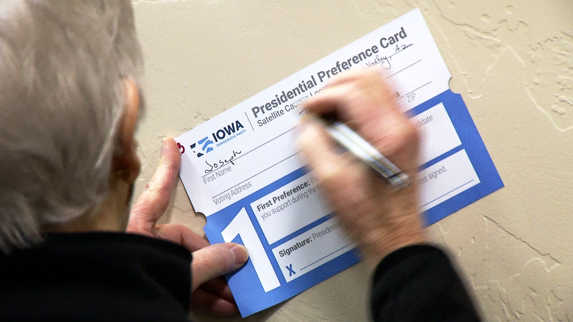 A man fills out a presidential preference card  for the Democratic Iowa caucus at a satellite event in Green Valley on Feb. 3, 2020.